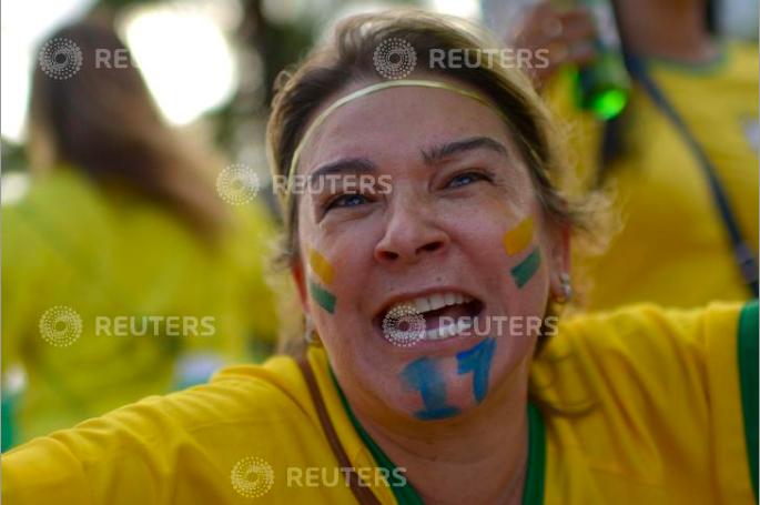 A supporter of presidential candidate Jair Bolsonaro reacts during a pro-Bolsonaro demonstration in Rio de Janeiro, Brazil September 29, 2018. REUTERS/Lucas Landau
