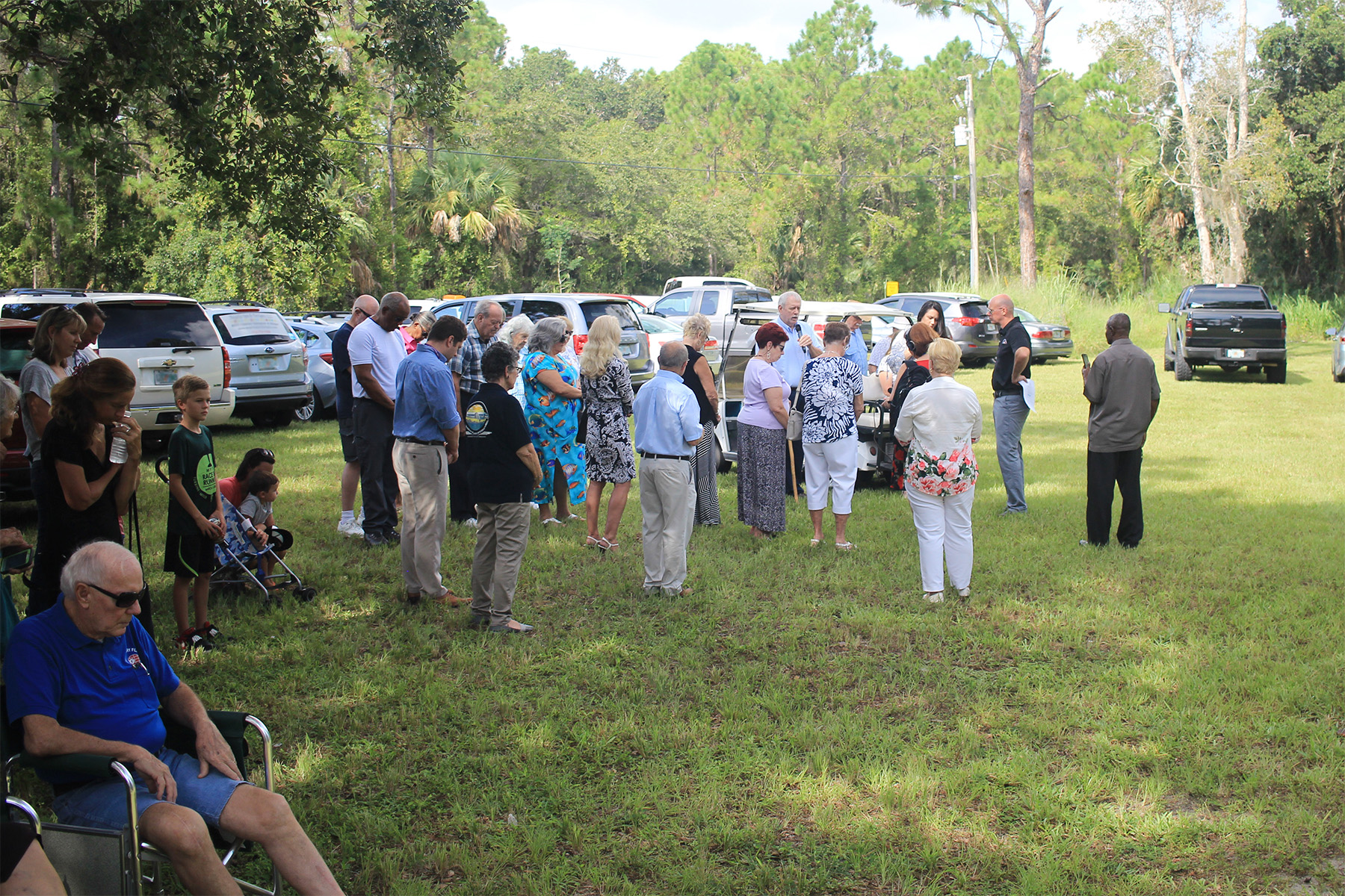 MFI Vice President, Mr. Larry Campbell, leads the crowd gathered for the Hospitality Park Ground Breaking Ceremony in a moment of prayer.