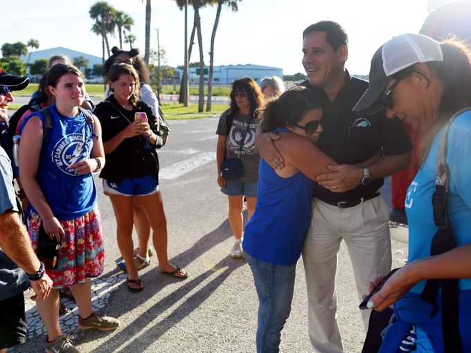 Kinsley Smith, with Agape for the Nations, shows appreciation for the work done by MFI by giving Joe Karabensh a hug! Photo Credit: Patrick Dove with TCPalm -  Click here for article