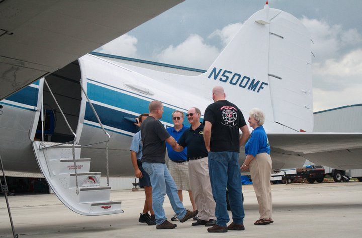 Brian Stoltzfus is welcomed by MFI President Emeritus, Dick Snook after arriving on N500MF in April 2011.