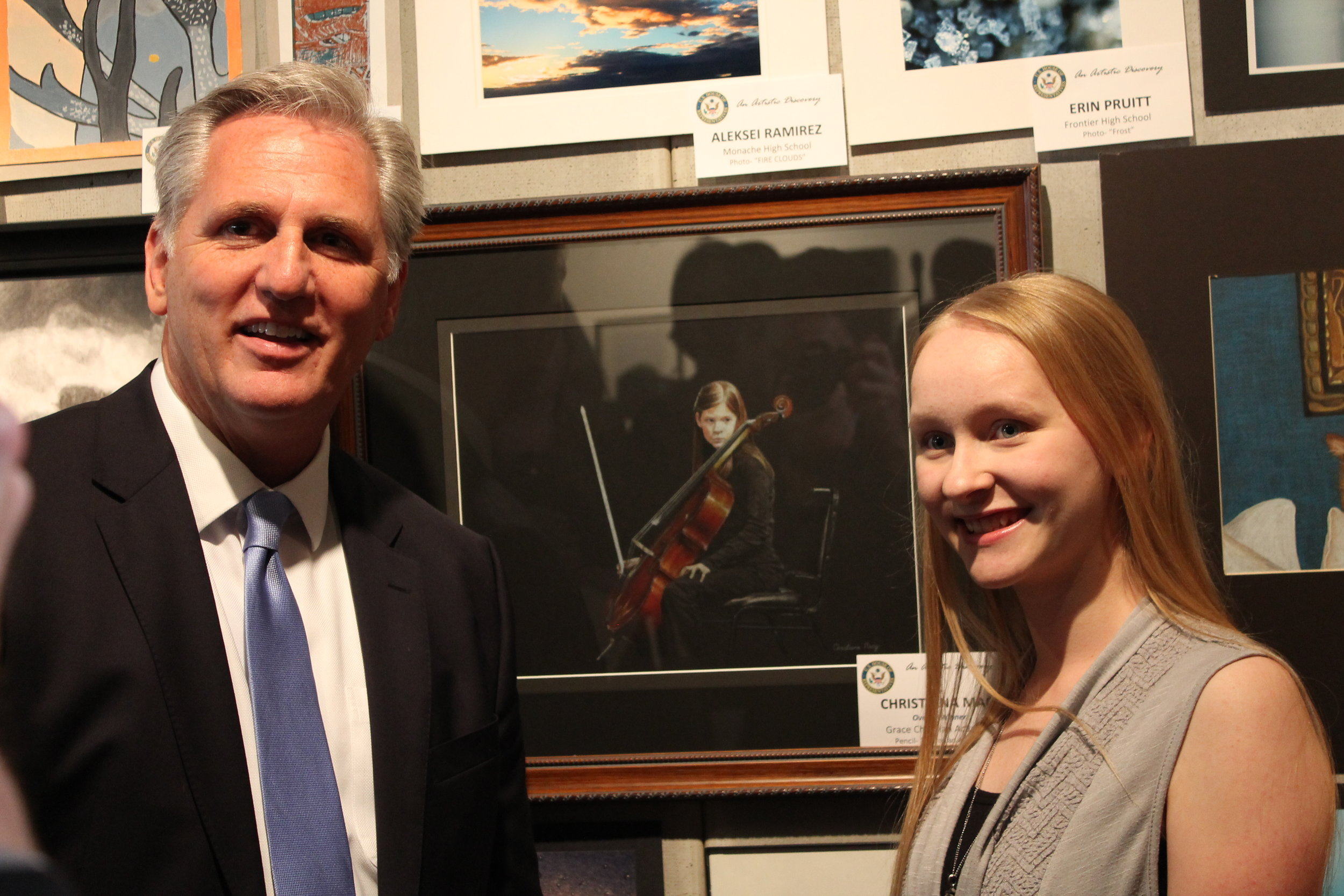 Congressman McCarthy and Christiana in front of her piece at the Bakersfield reception.