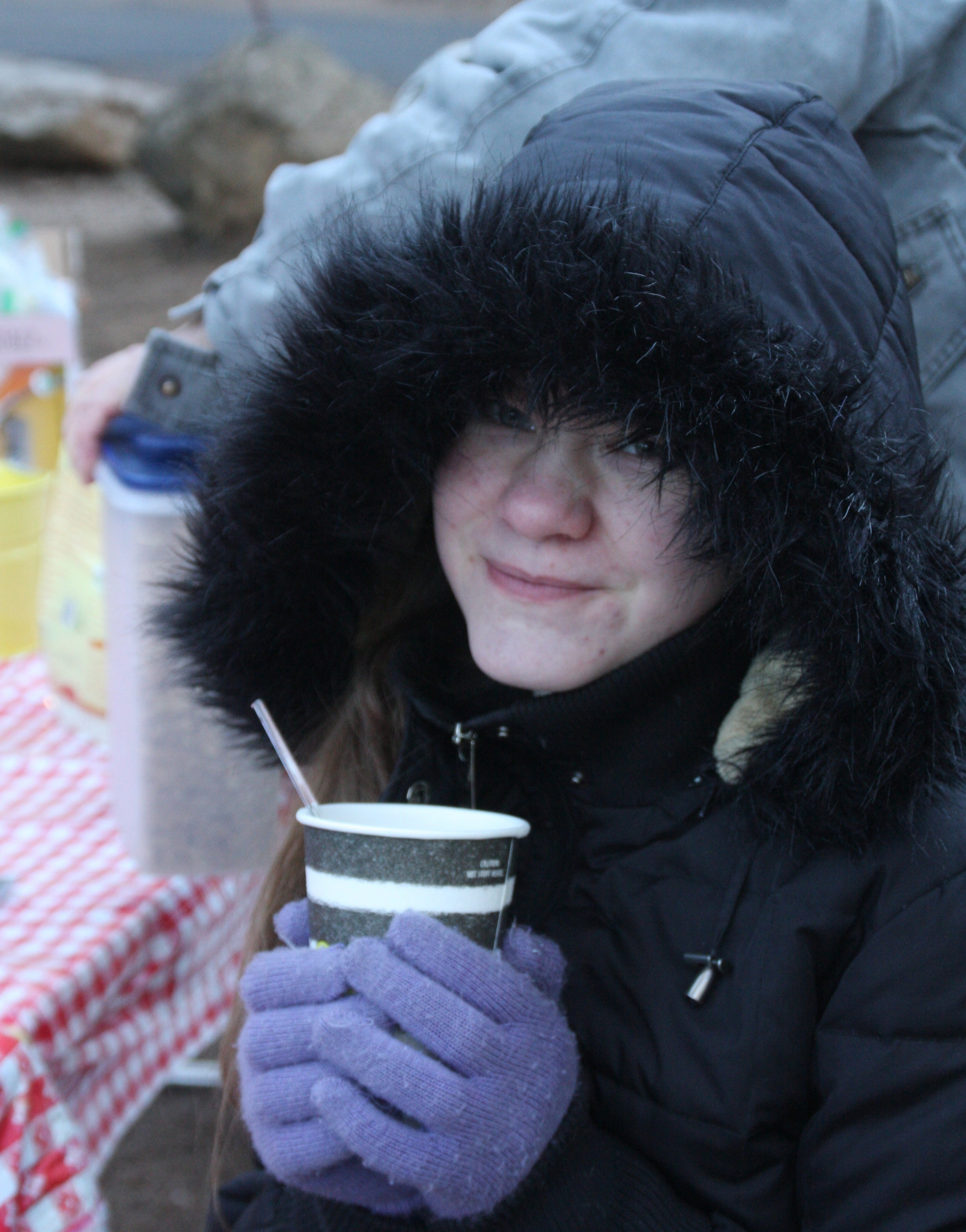 Susanna trying to stay warm while eating breakfast.