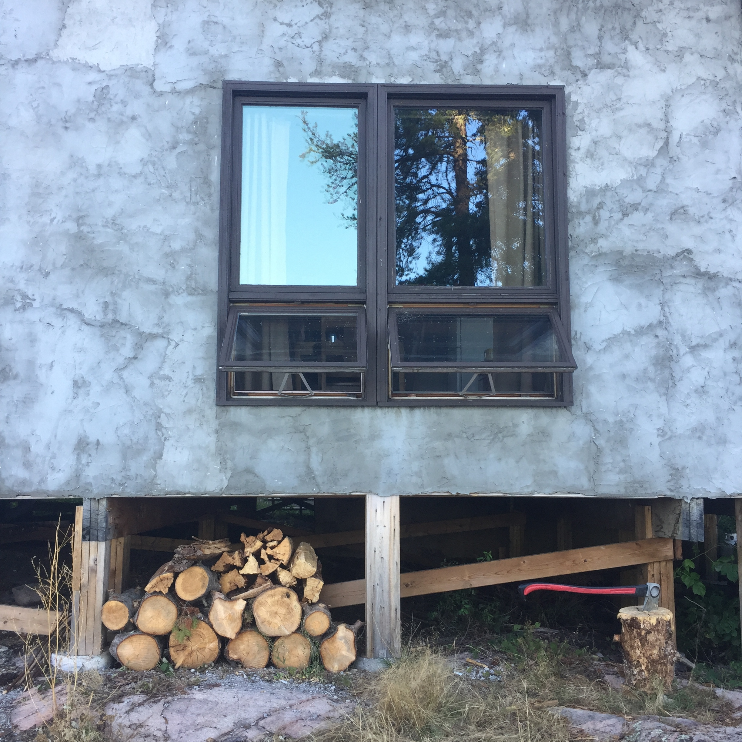 Cross-ventilation and firewood stack.