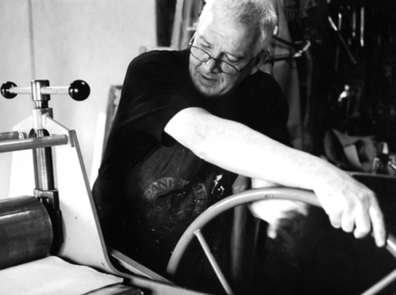 A book by Dick Groot on artists living and working around the Bay of Fundy included this strong black-and-white photo of Bob working his large intaglio press.