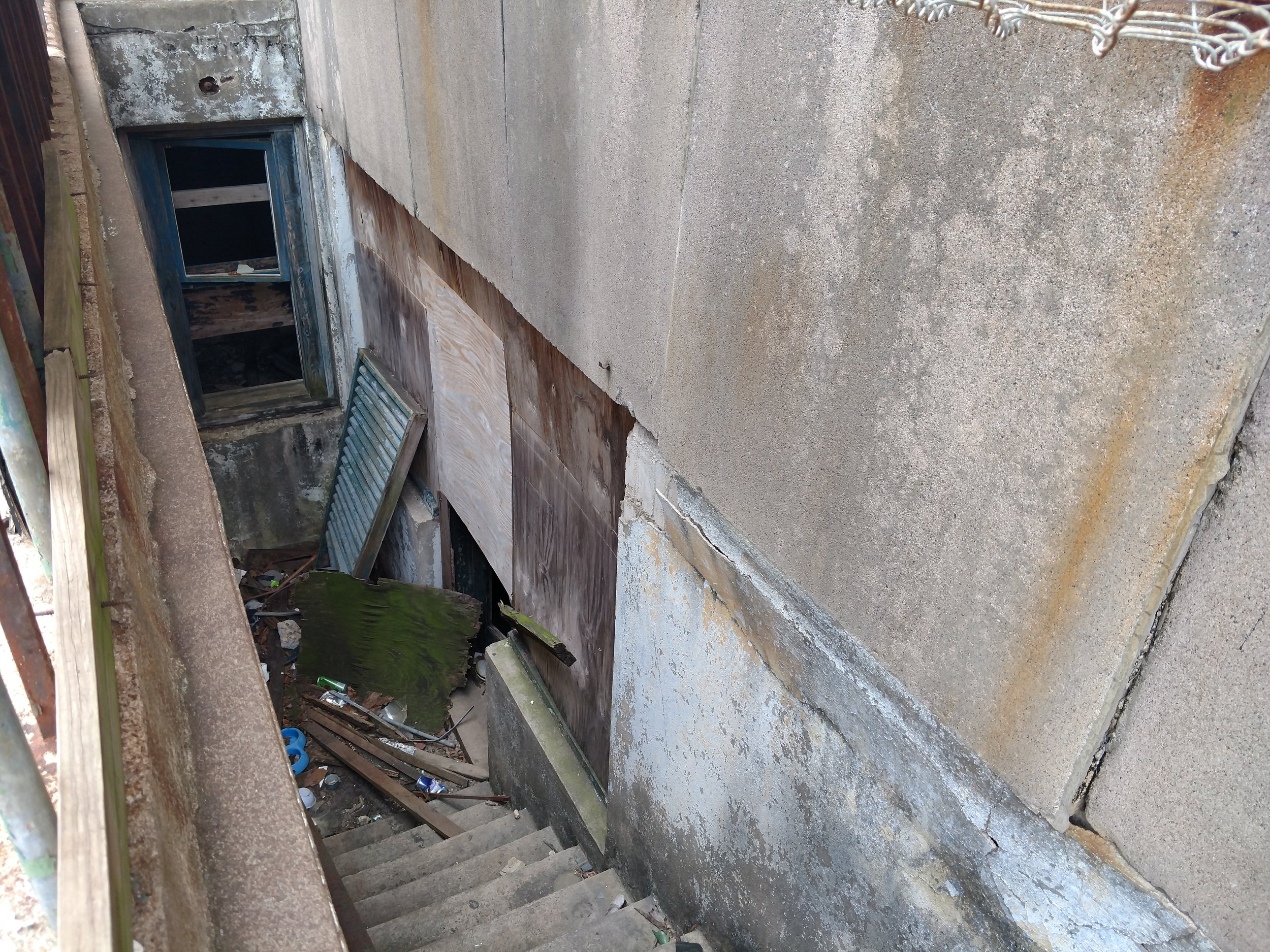 A view of one of the entrances going down below. There is fencing around it but it has been pulled back.