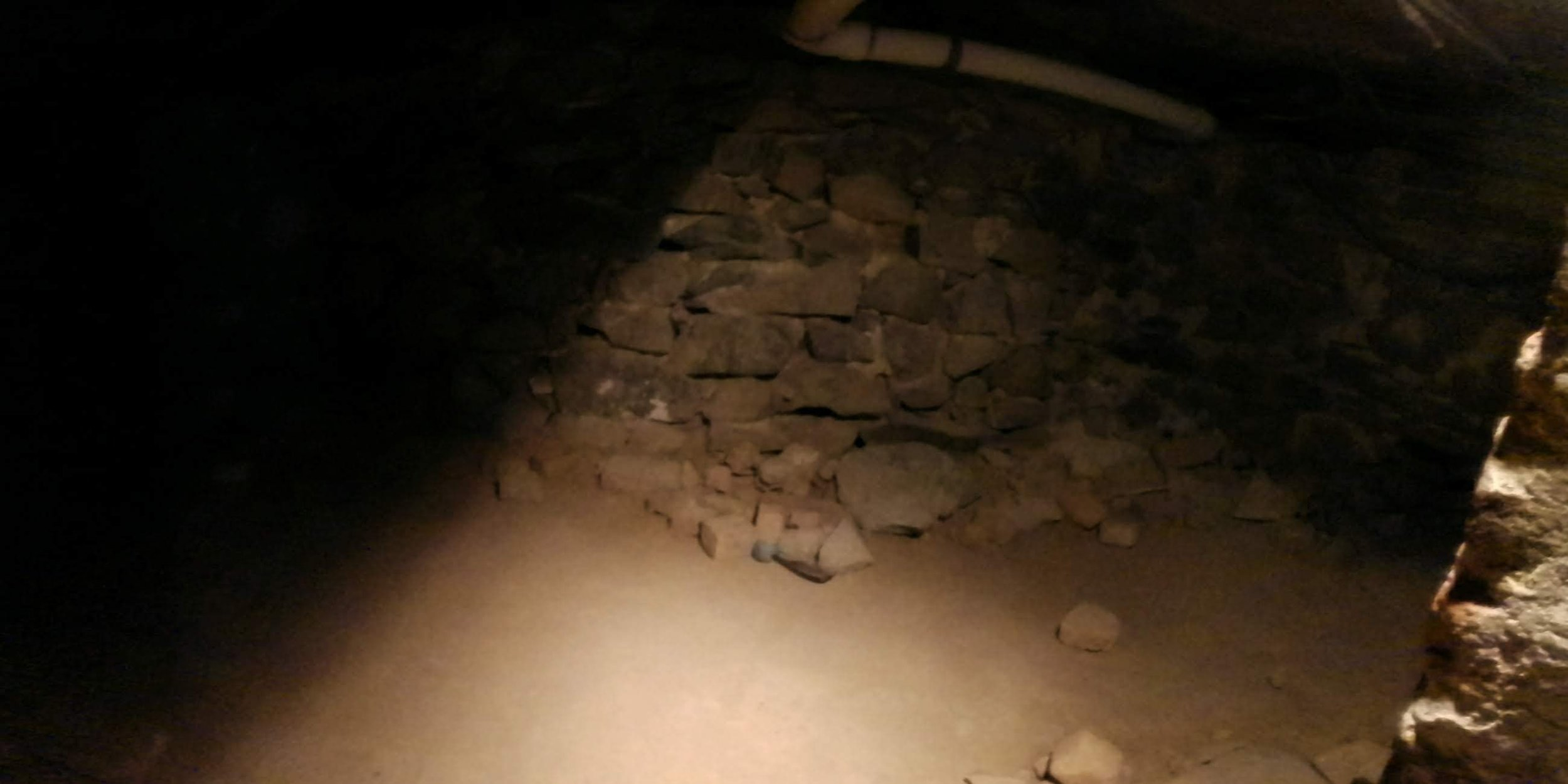 Photo from the basement with the black anomaly in the upper left corner.