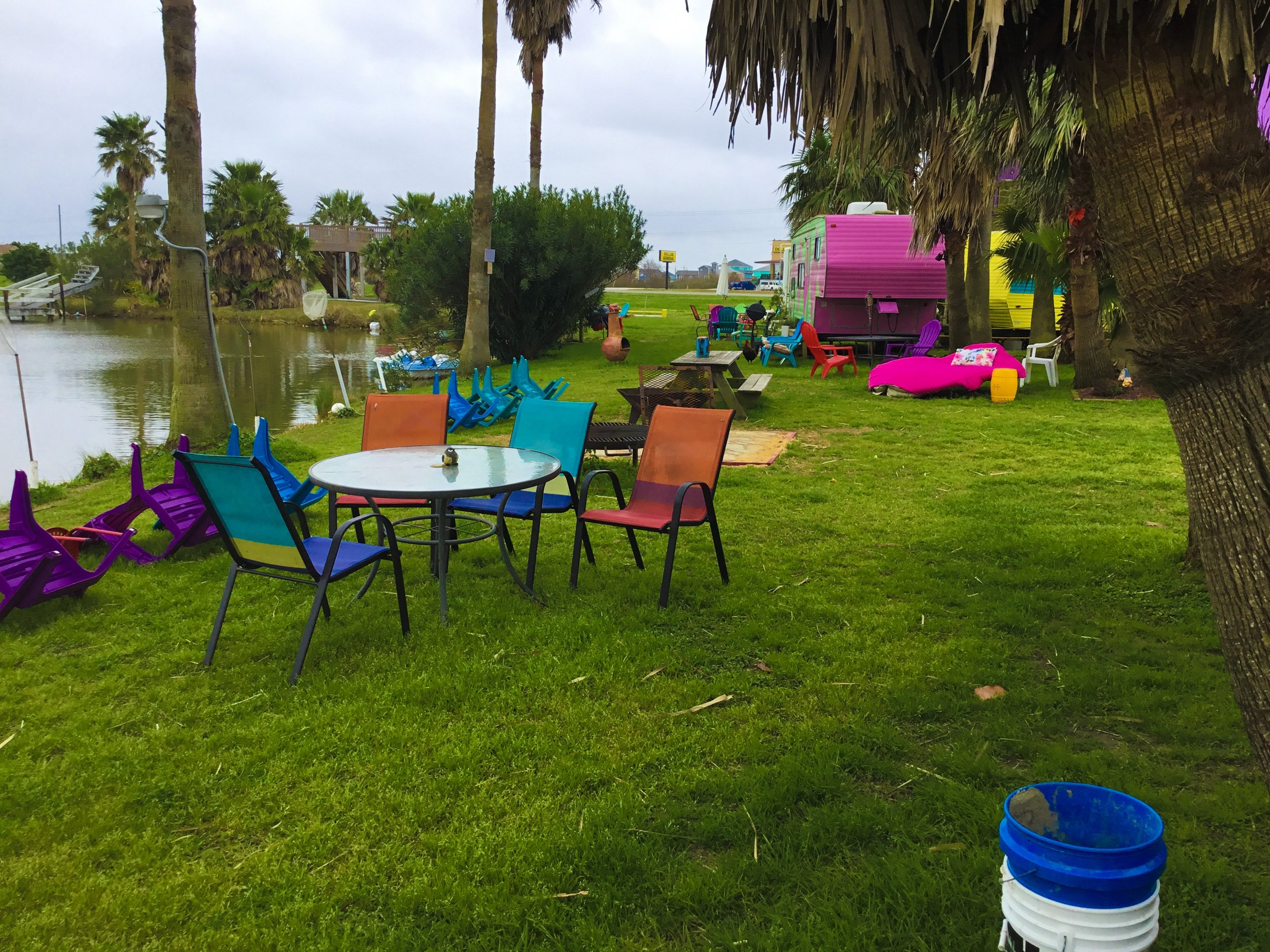 Tables, chairs, fire pits, and grills are common near all of the units.