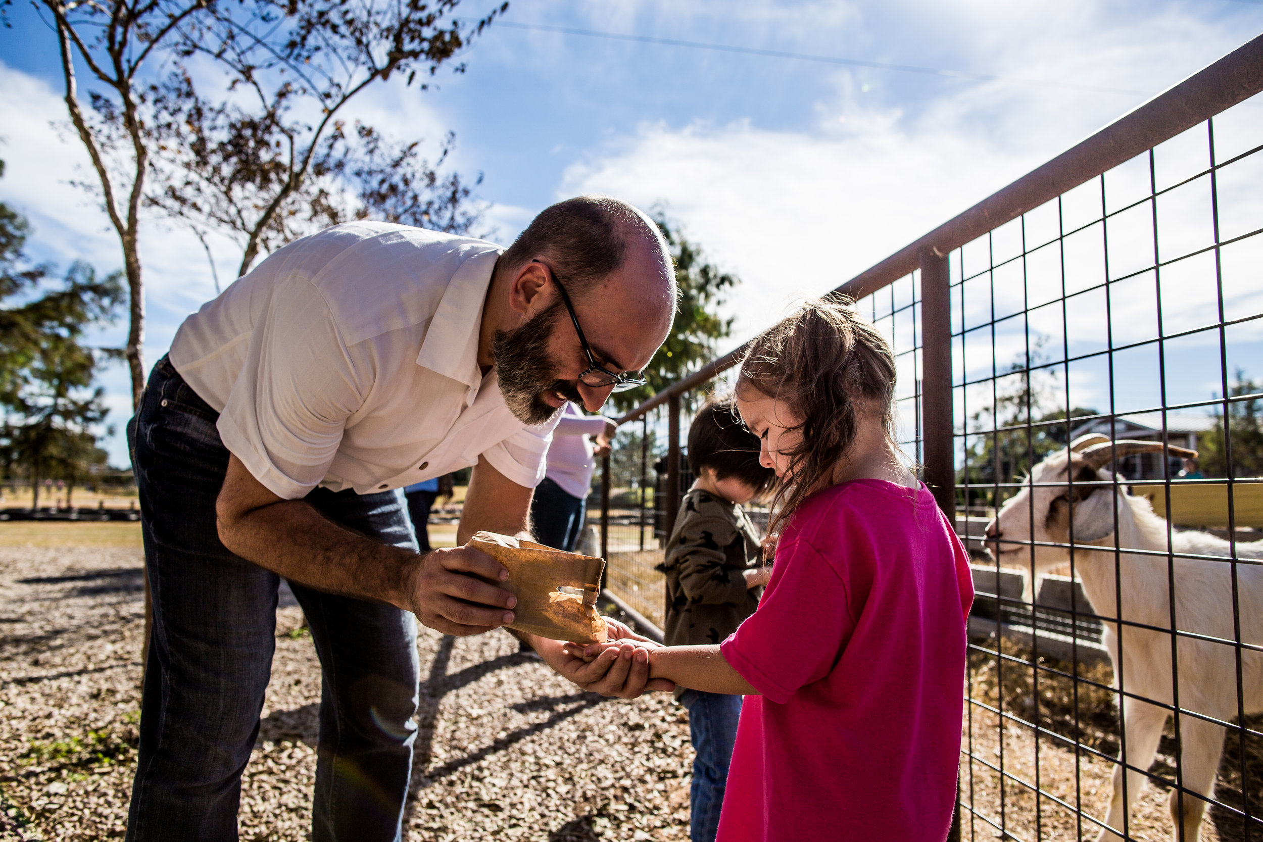 Feeding the goats at Devine Acres Farm. Devine, TX. Photo by Norma Hess Photography rgvbirthphotography.com
