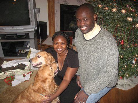 Christmas '08: My cousin, Dr. Kafui Demasio, and her rambunctious Golden Retrievers: Odysseus and Cecelia.