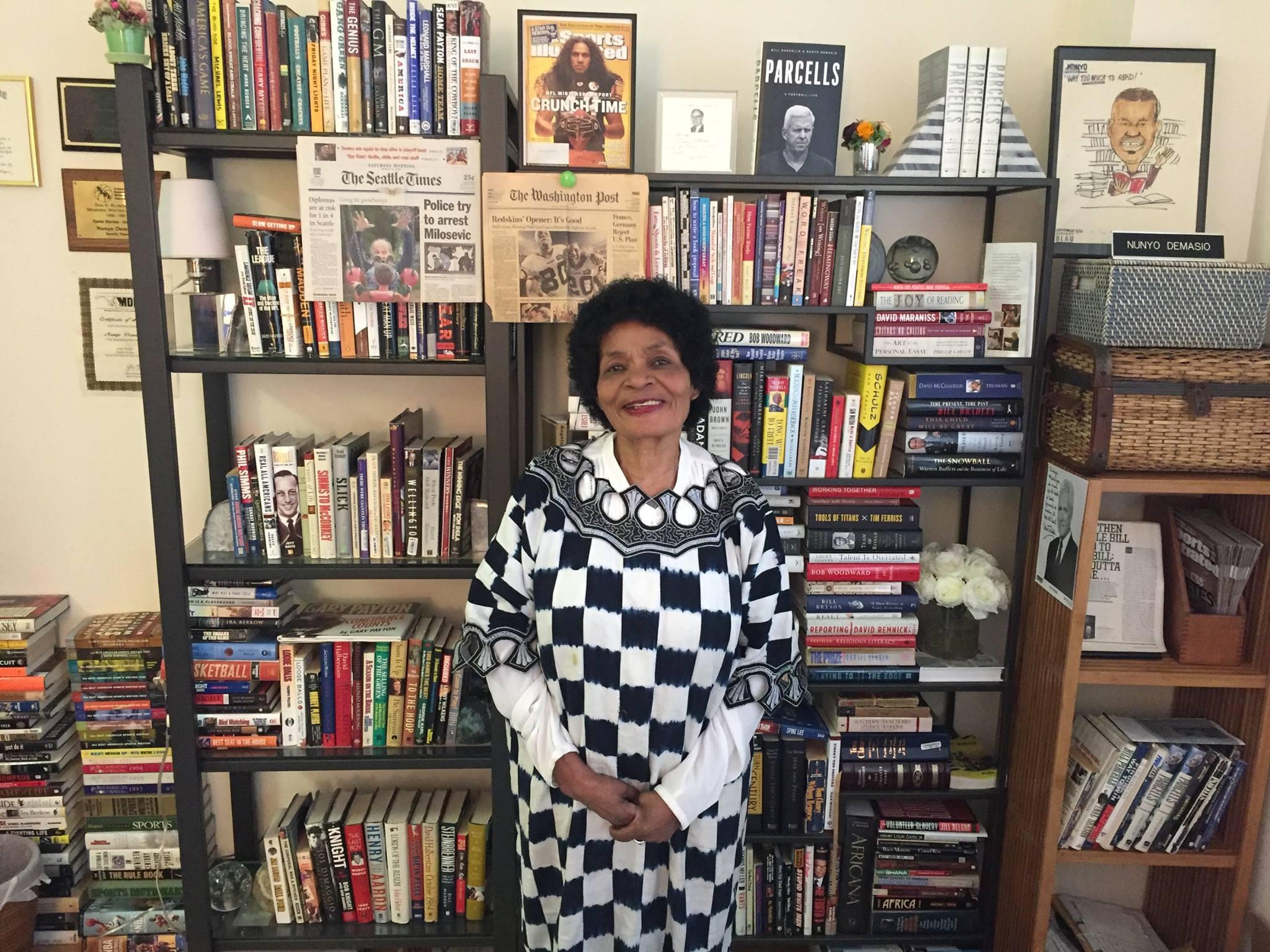 Queen Dorcas in front of my book shelf during summer 2017.