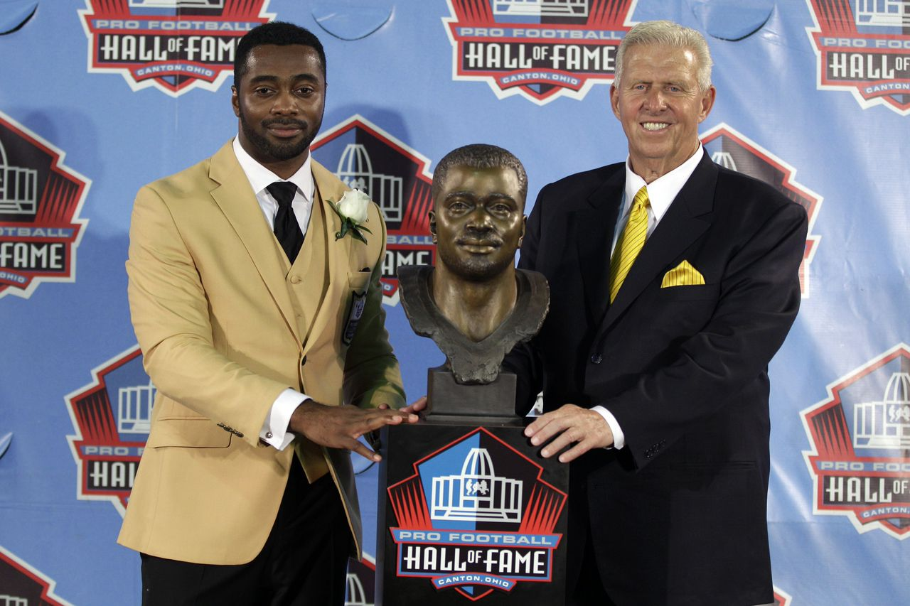 "Curtis Martin and Bill Parcells flank a bust of Boy Wonder at the Hall of Fame on August 4, 2012. Parcells, a father figure to the former Patriots and Jets tailback, presented him in Canton, Ohio. Martin had felt bittersweet on February 4, 2012 when he learned the news about his election into the Hall -- only because Parcells failed to also make the final cut. Martin explained, ""There's God and there's Parcells as far as the impact they've had in my career."" The pair had fantasized about being enshrined as part of the same class. (Gene J. Puskar, AP)"