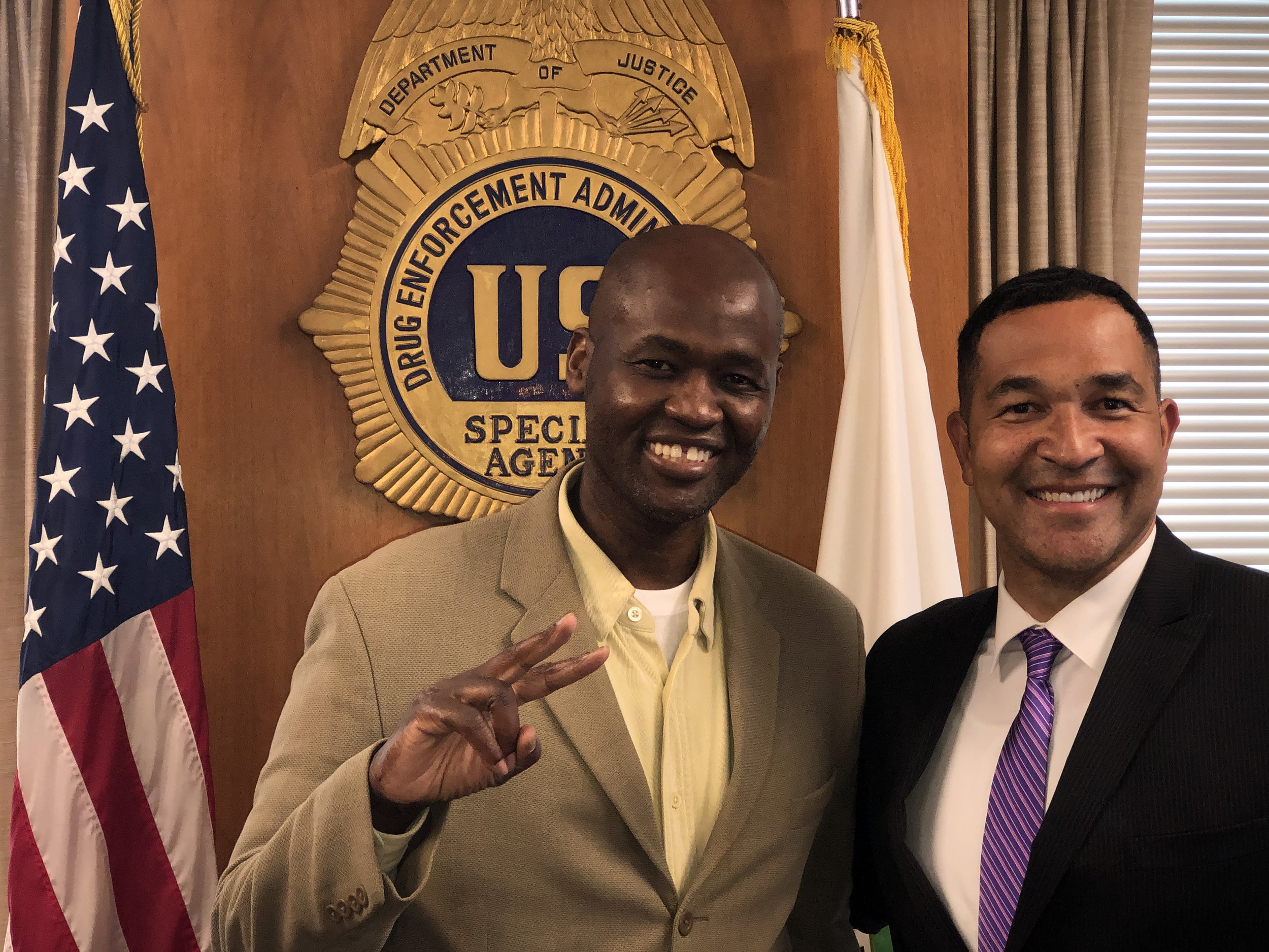 """Ray Donovan welcomes Nunyo Demasio, host of NUNYO & COMPANY, to his Manhattan office during summer 2019. (In case you're wondering, the DEA agent is half Irish and half Puerto Rican. Don't pretend you weren't trying to guess his ethnicity! Ray is not quite a """"brother,"""" like Nunyo who actually has an Italian last name. 🙃."""