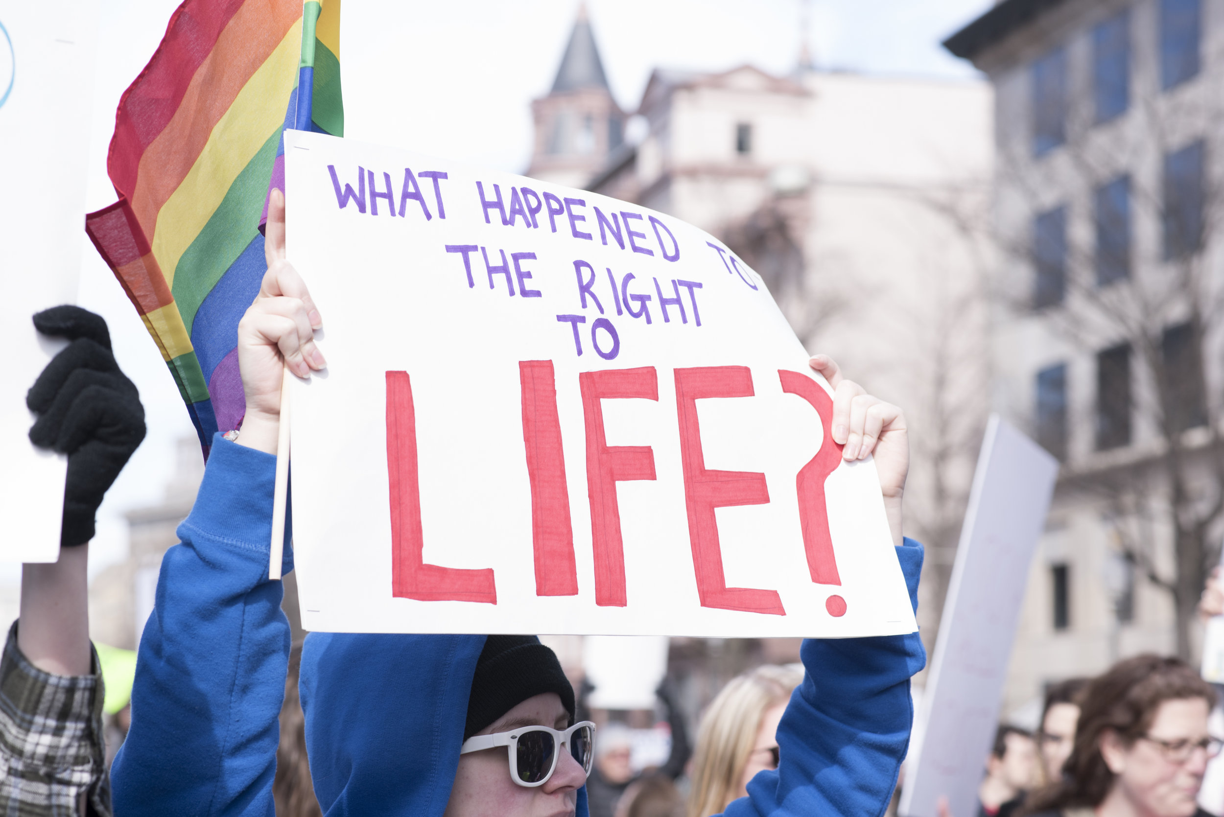 """March for Our Lives, Washington, DC: March 24, 2018. Student holding sign, """"What happened to the right to life?"""""""