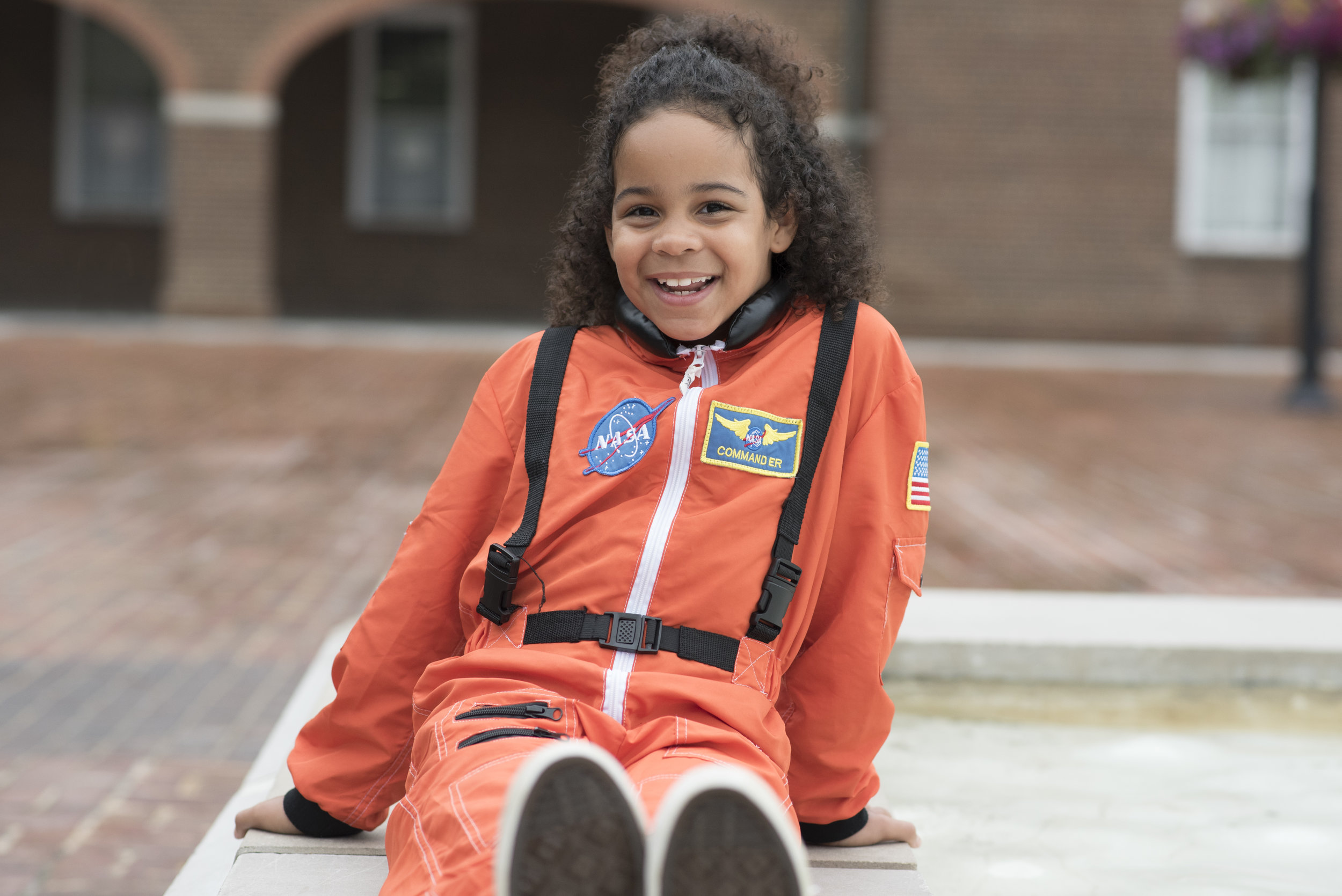 Portrait of Havana, a 7 year old activist, in her astronaut suit, in the location she delivered a speech at a Moms Demand Action rally.