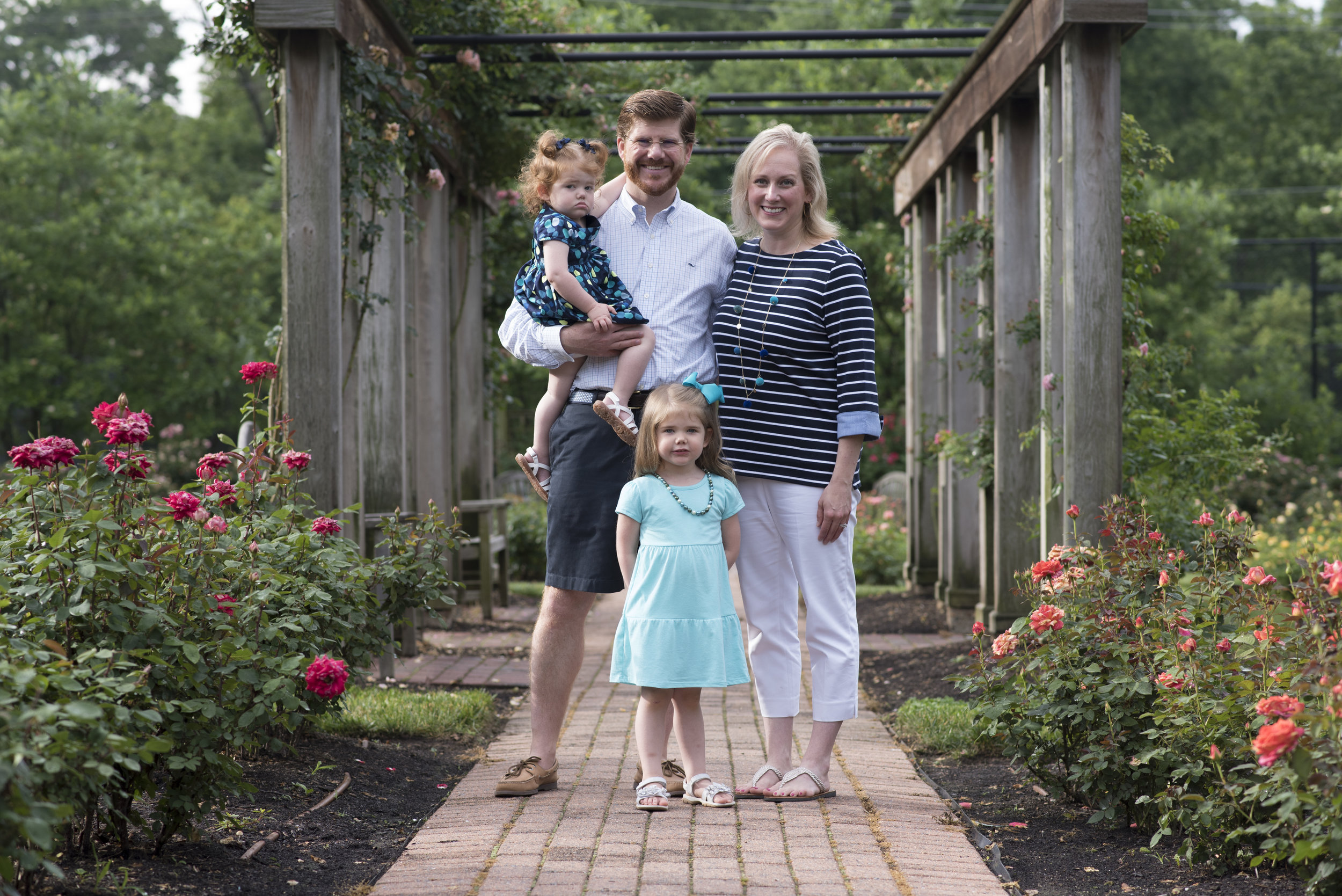 Family of Four - Color scheme of analogous colors in blues and greens stand out beautifully against pink and red roses.