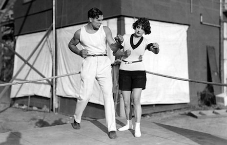 Jack Dempsey teaches his Wilmington bride, Estelle Taylor, a few boxing moves.