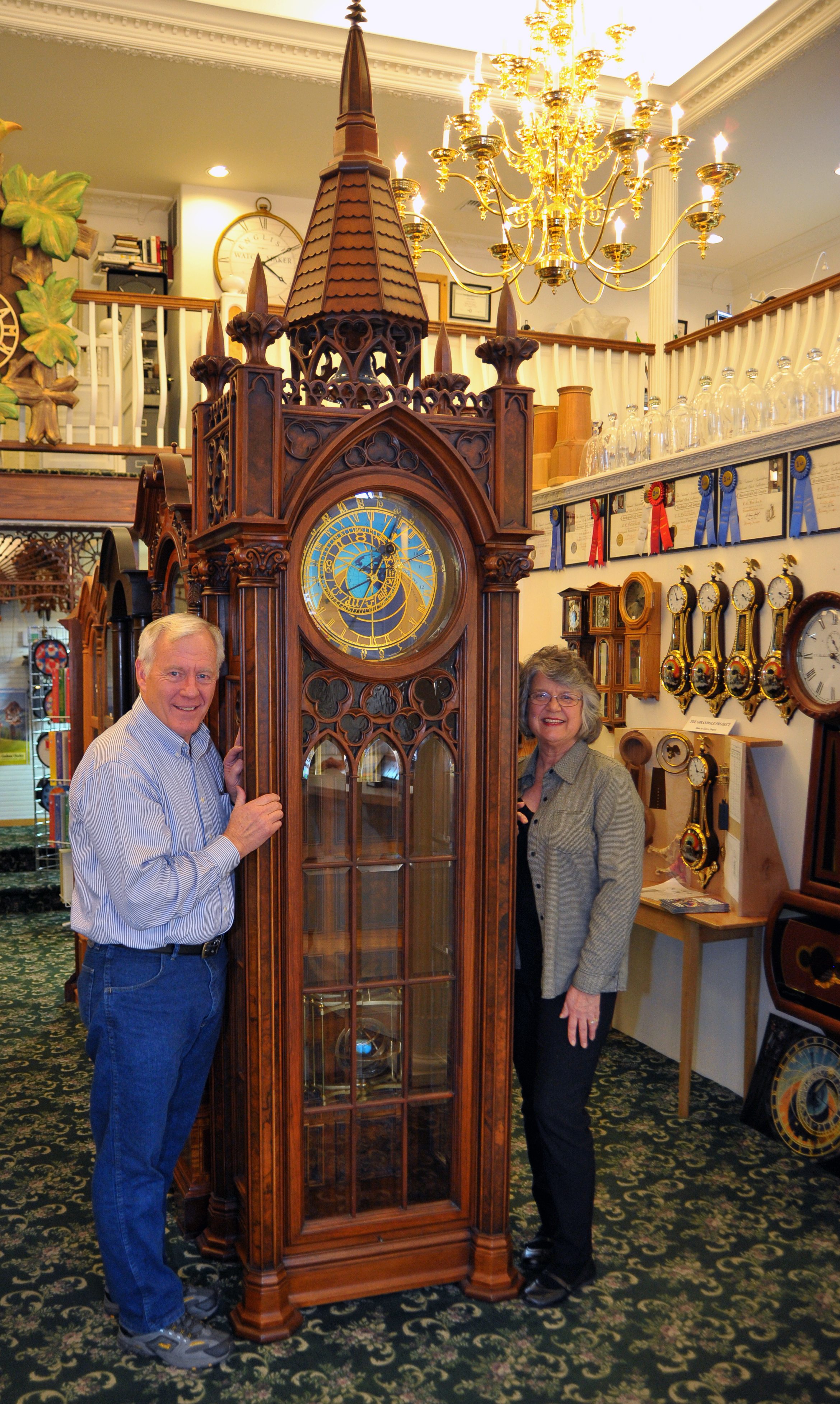 Ed and Kathi Beacham next to Ed's Prague clock reproduction