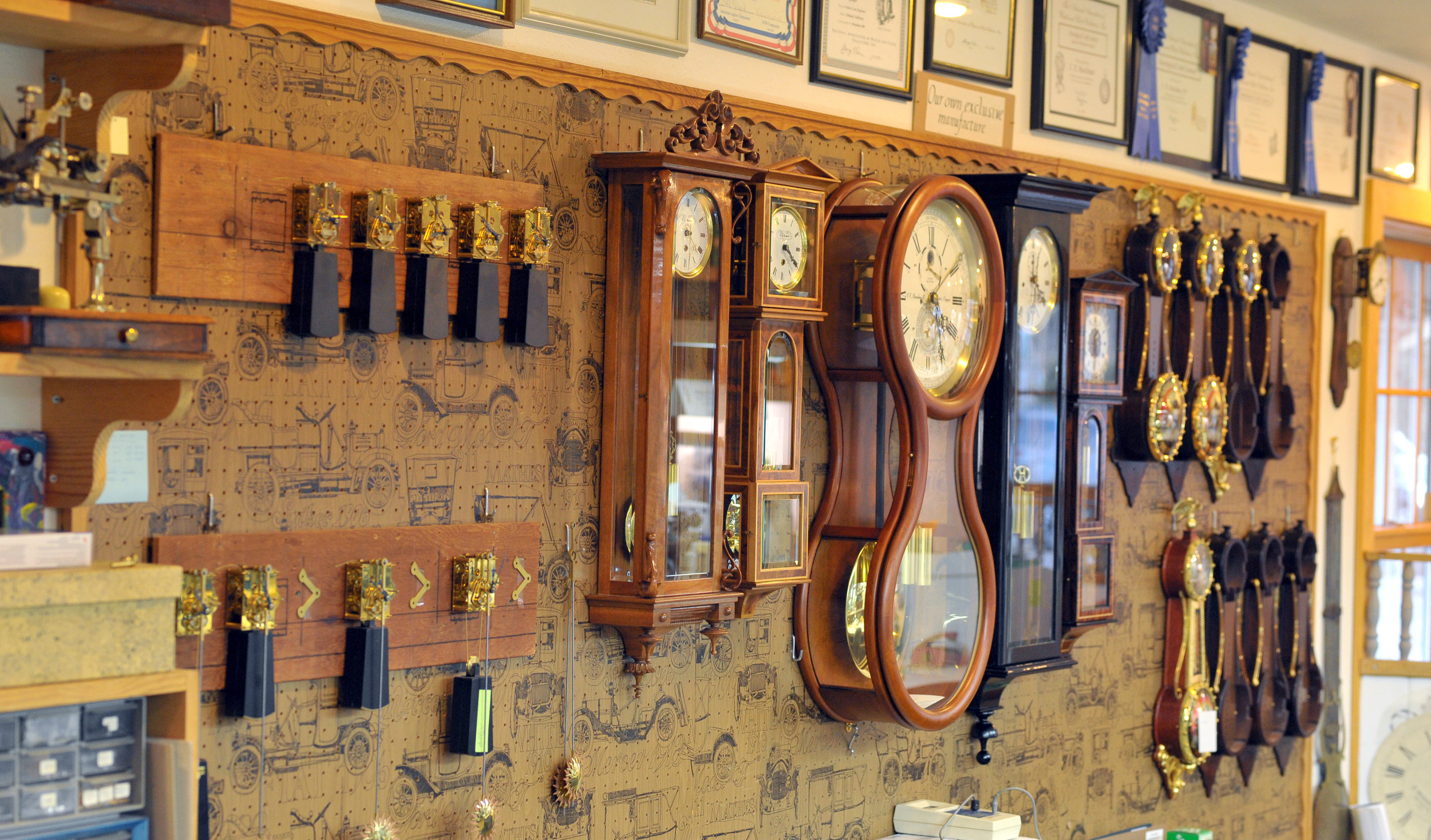 A sampling of Ed's clocks both finished and in the manufacturing process