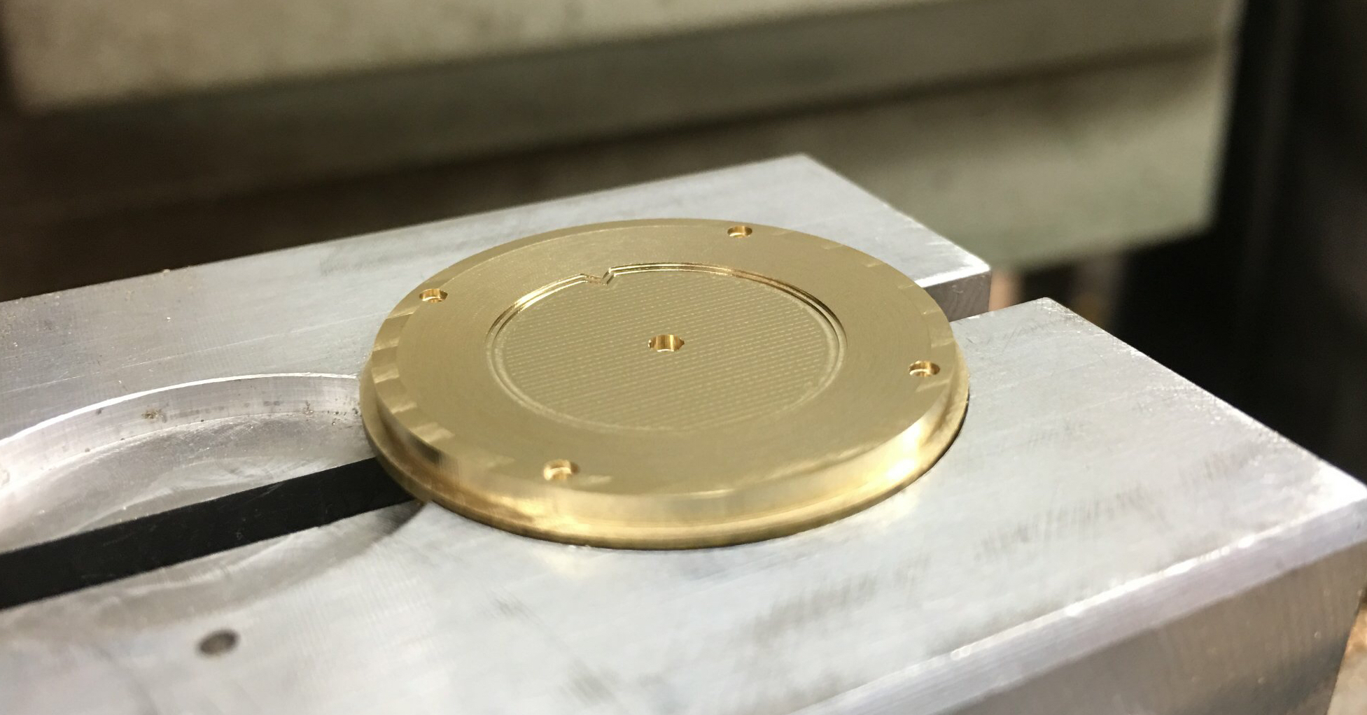 A raw machined dial ready for finishing.