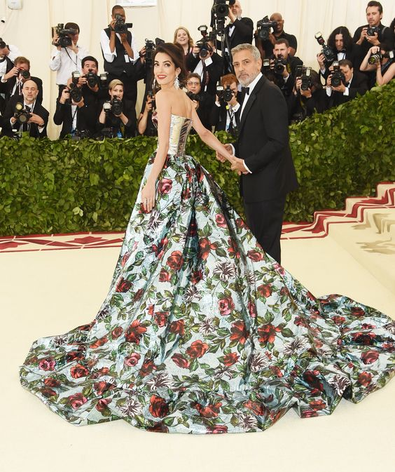 Amal Clooney stunned in a floral gown that doubled as a pantsuit. I do not like the front of the gown but the back is gorgeous. Also, George, some effort here please?