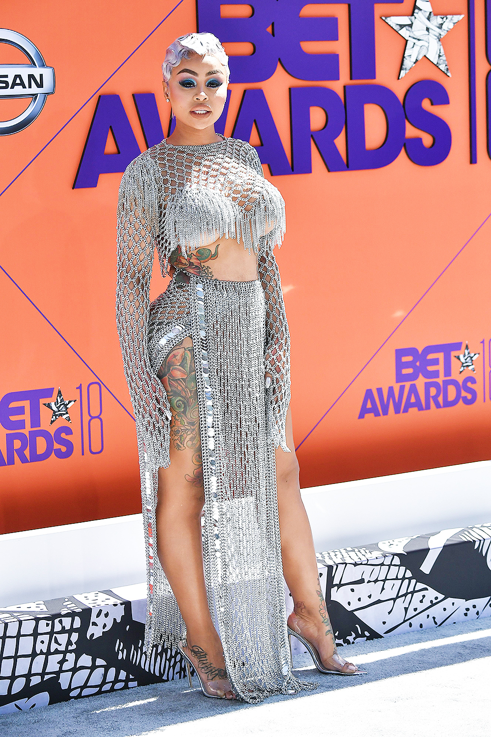 Blac Chyna glistened in a popping platinum two piece set! Despite the fact that I am not into chain mail, I truly enjoyed this look.