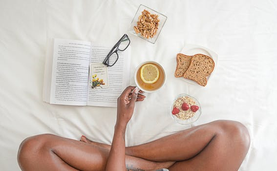 Pexels  -  https://www.pexels.com/photo/person-holding-white-ceramic-mug-with-lemon-near-book-and-sliced-bread-on-white-comforter-1065588/