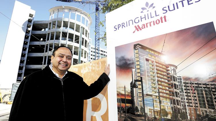 Vinay Patel, CEO of SREE Hotels, stands in front of the construction site for the new Springhill Suites Marriott that is adjacent to the uptown area.