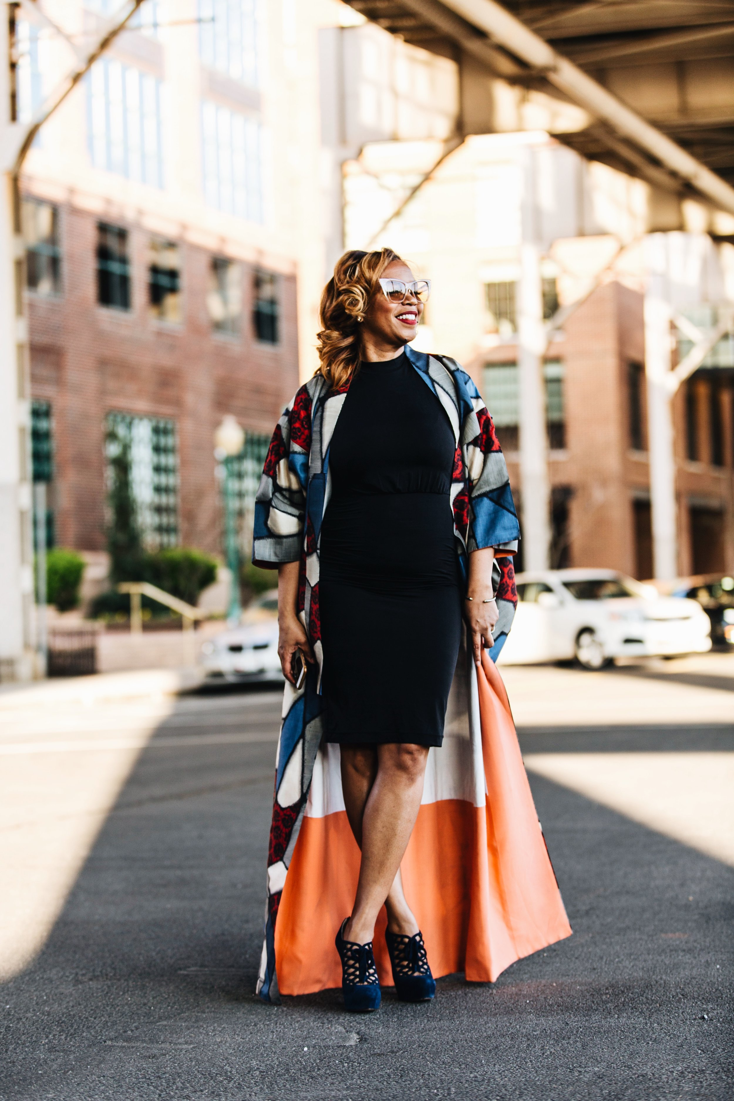 A image of personal stylist looksbybloom wearing sunglasses, black dress, multicolored patterned kimono captured by photographer The Creative Gentleman for Fashion Bomb Daily. This image was captured during the Conversations with Claire brunch event in Washington, D.C.