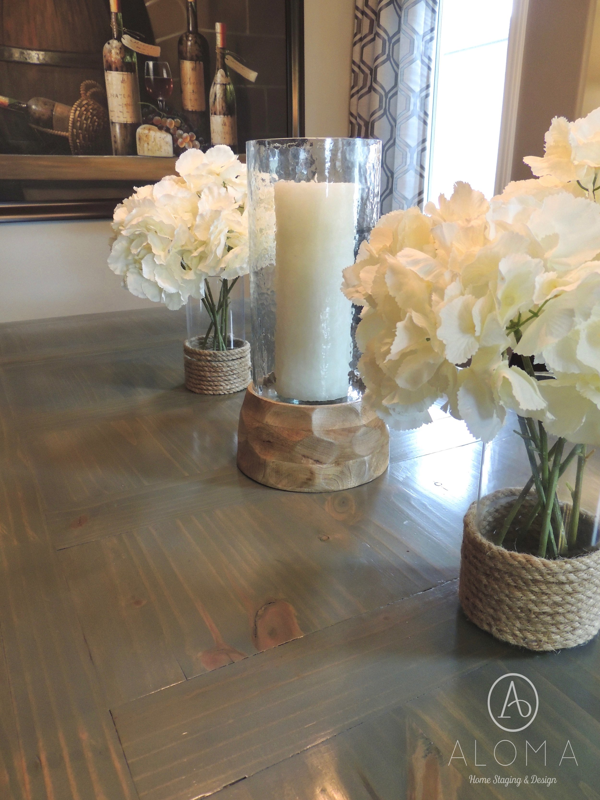 Rustic dining table centrepiece by ALOMA Home Staging & Design
