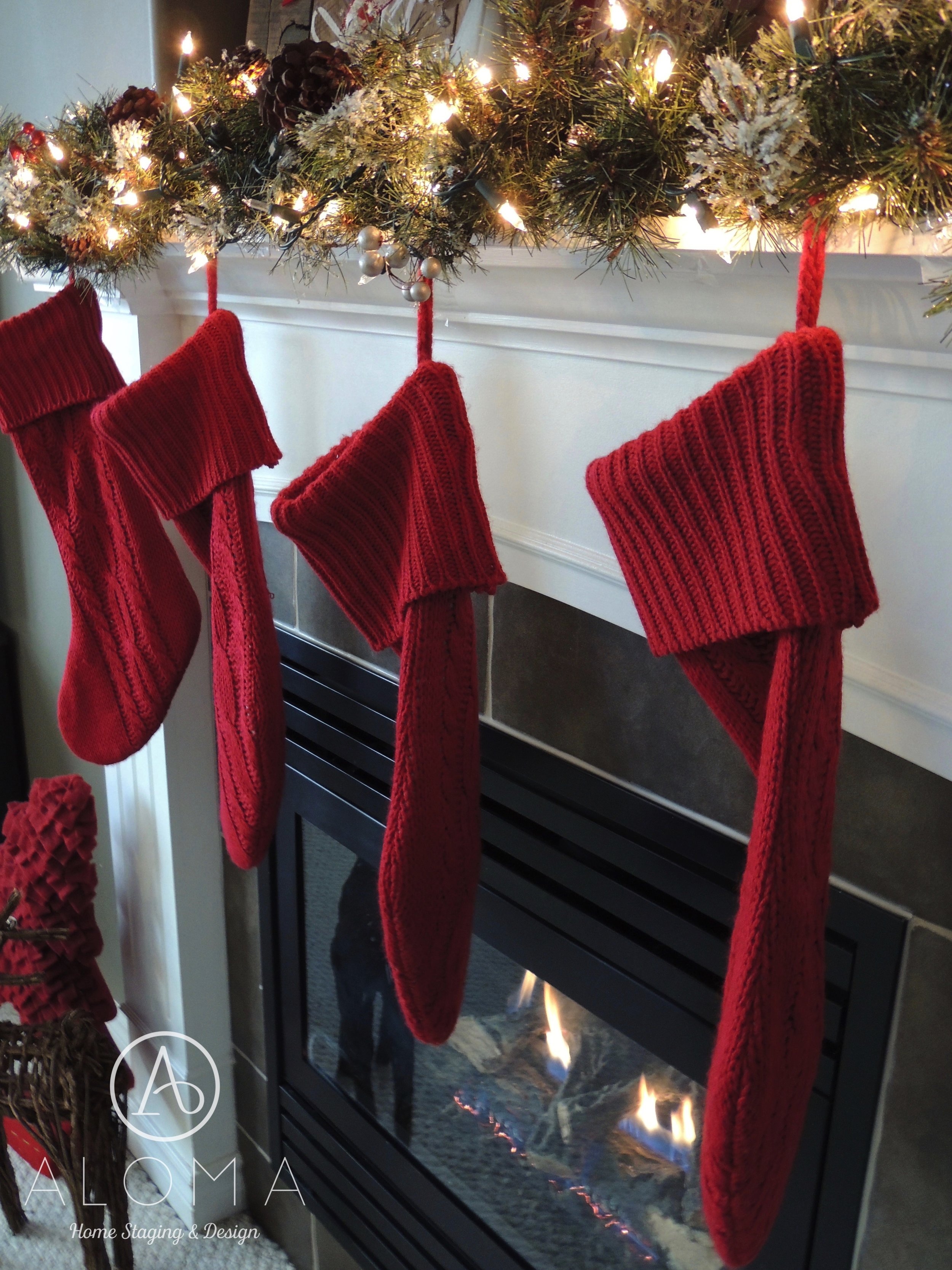 Christmas Mantle with Red Accents by ALOMA Home Staging & Design