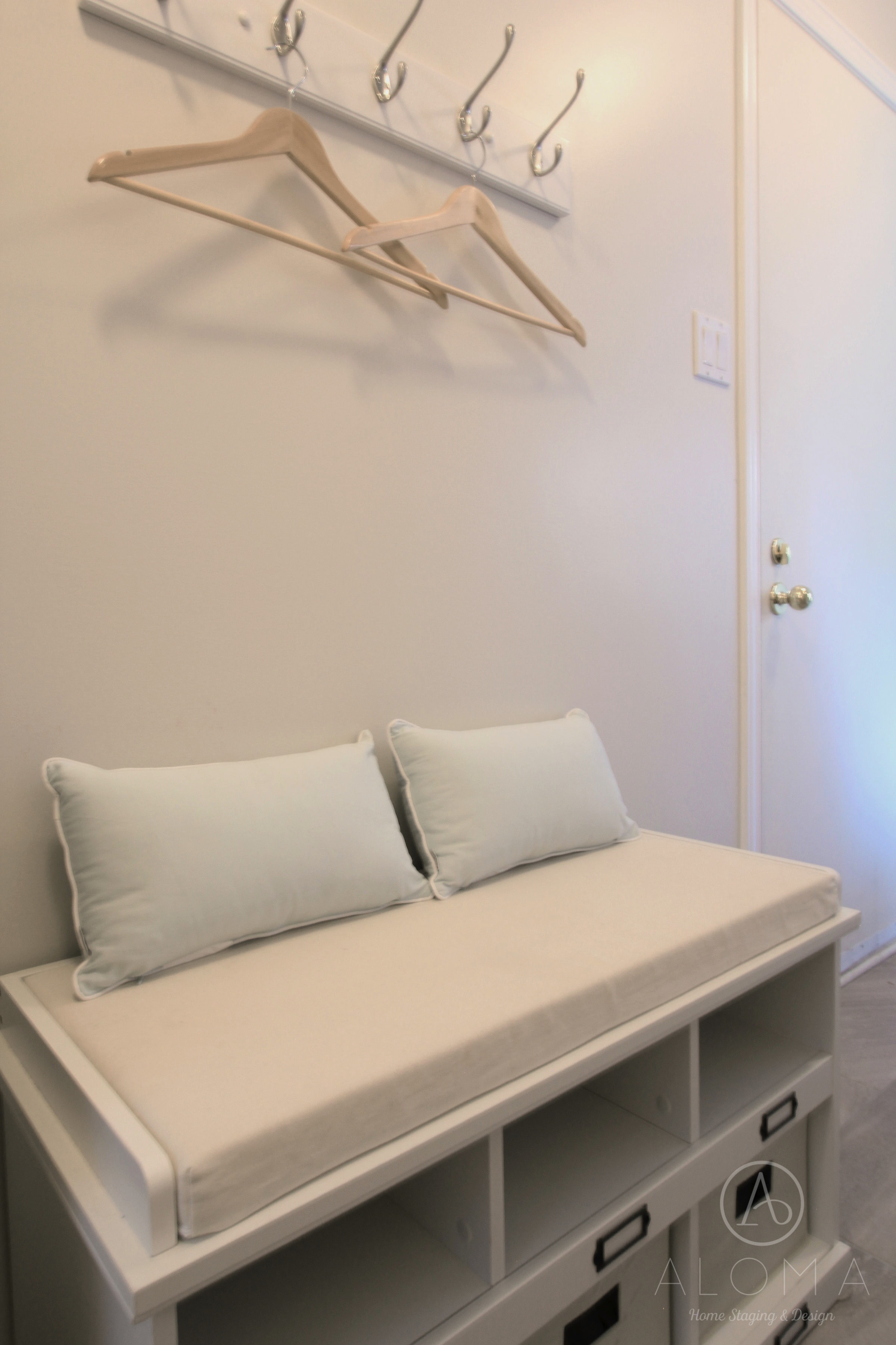 Storage Bench with pillows by ALOMA Home Staging & Design