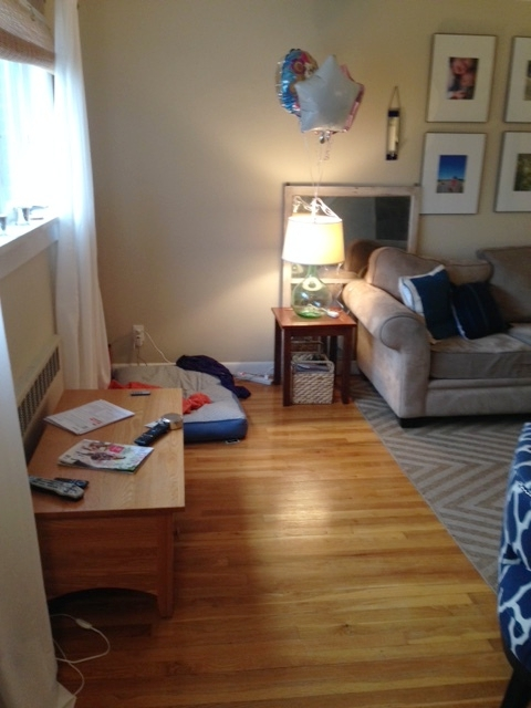 Since this room was originally two spaces, it's rather lopsided with one end of the space being emptier than the other. This is usually where we drop the groceries. The coffee table is under the window here, in limbo, in the midst of my post-Christmas rearranging frenzy.