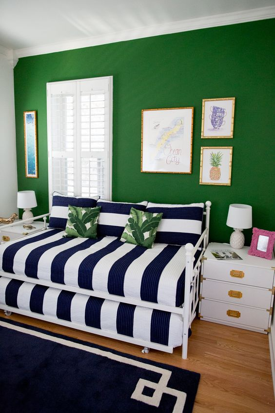 This guest room from  Kelly in the City  is so cheerful and chic.. You can't get more preppy than green with navy + white stripes. I love the coastal touches and the pop of pink, and really, with the tweak of a few accents colors/patterns, it could work for almost anyone and any room.