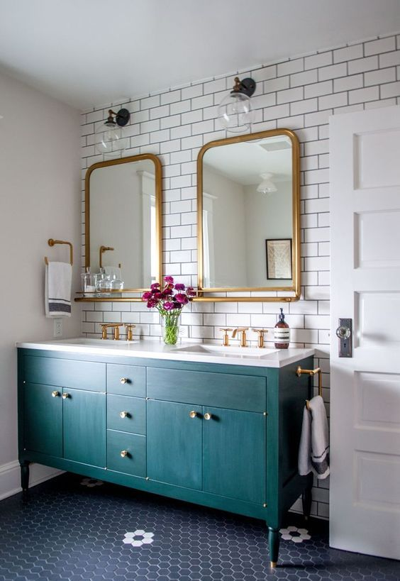 This bathroom is timeless and classic paired with black, white and brass finishes.