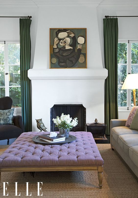 Ginnifer Goodwin's elegant living room uses an earthy green that harmonizes with the neutral palette and warm textures.