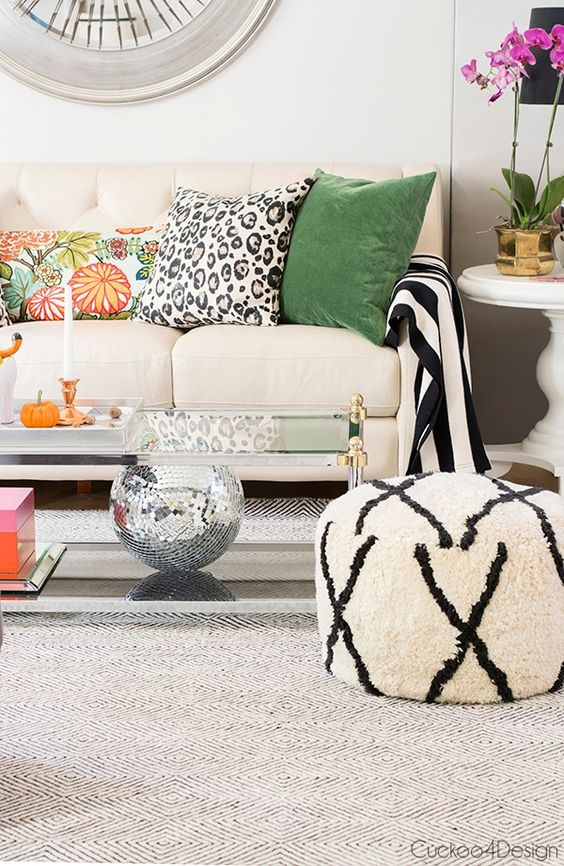 In  this fun room , the solid green velvet pillow grounds the other patterns and colors and makes it feel sophisticated and pulled together.