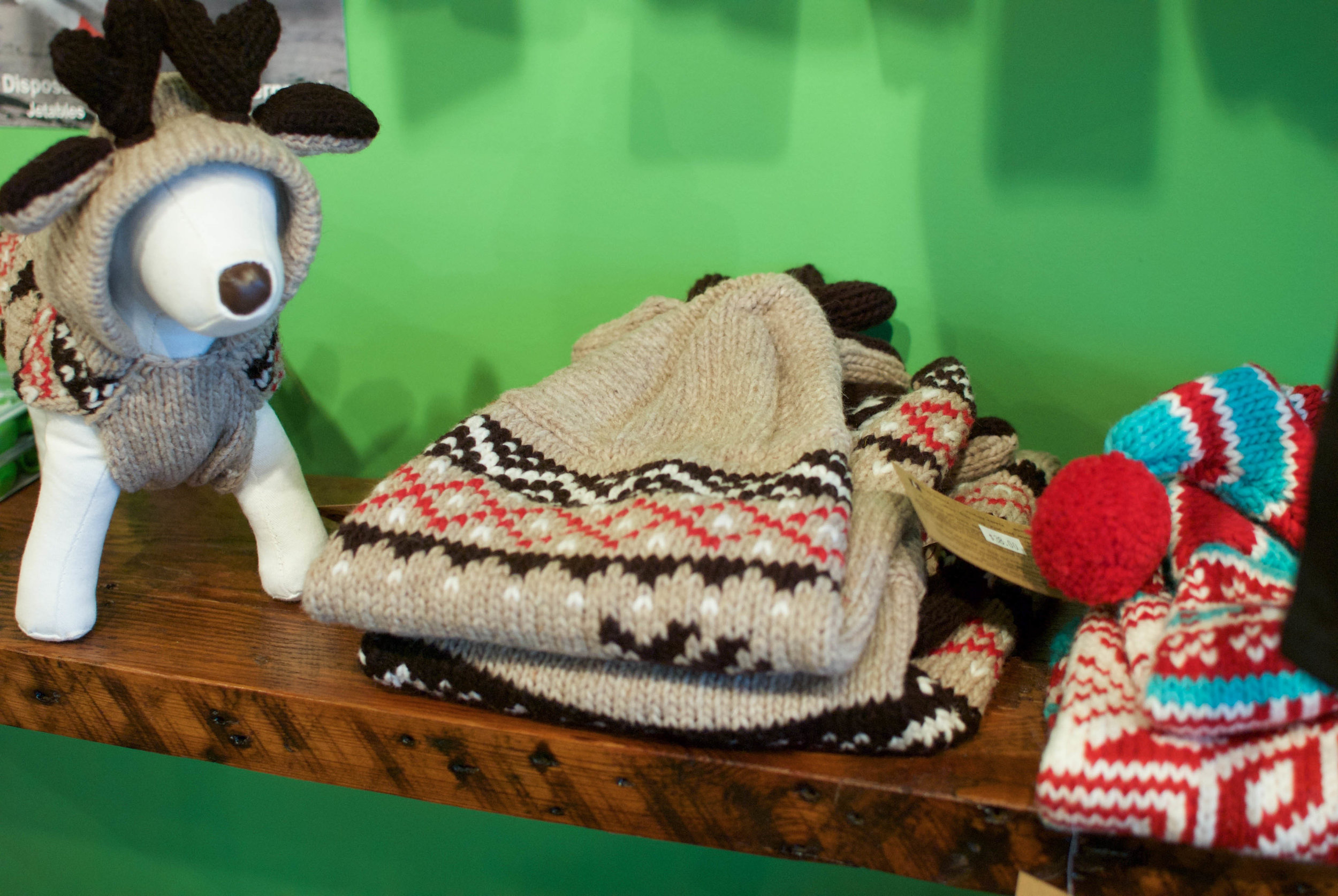 Paisley loves these sweaters. Hand knit, cozy goodness.