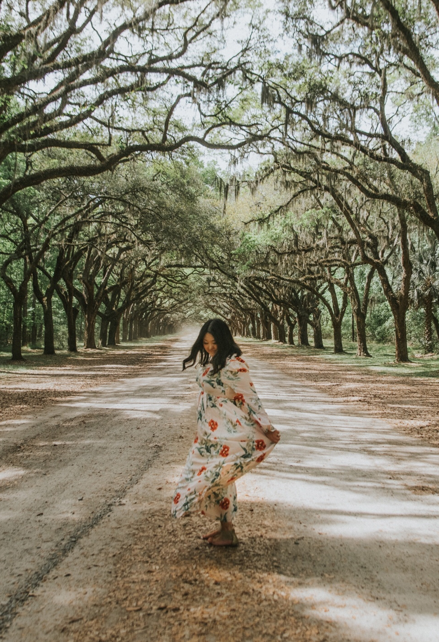 If you want to, do it for the photo (proudly). - Friends, if you want a cute photo of you or your family it's okay to intentionally pack/wear an outfit for a specific location or day. I knew that we wanted to visit this row of oaks in Savannah and loved the idea of this flowy, floral maxi there. Did I wear this dress for that purpose? Yep. Did I wear it romping through the woods on the grounds? Yep. While it doesn't need to be the focus of your trip, it's okay to dress for the photo opp without shame.Tip #5-Be okay with wearing a cute outfit with a photo in mind. No shame in the game.PS-Wasn't alone. While we were there someone showed up in full glam for a quick photo in front of the trees before heading into the museum. You're my kinda people.