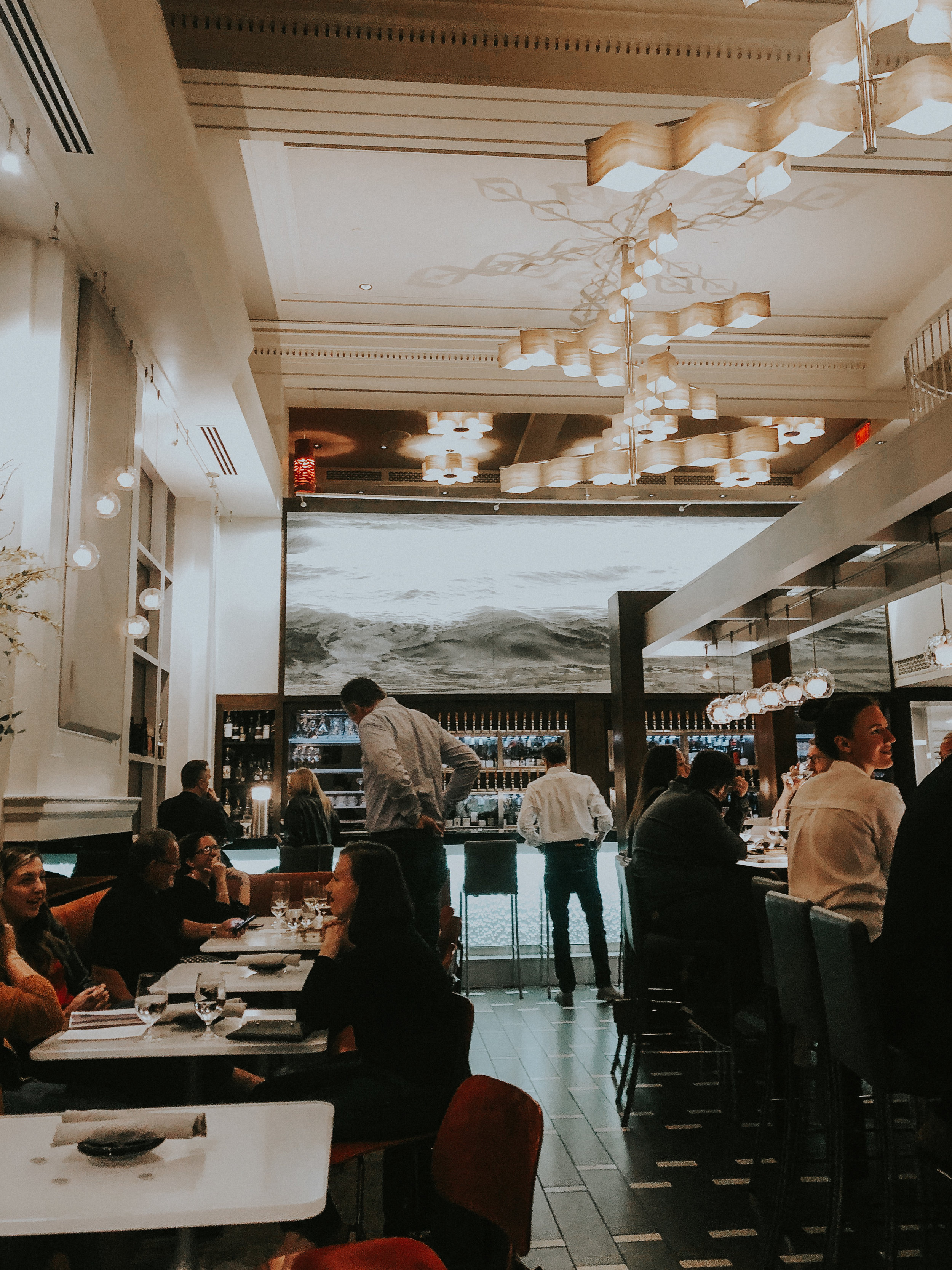 Reserve - 201 Monroe Avenue NWIf wine, great atmosphere, or delicious food are of interest to you, Reserve should be at the top of your list. Neighbors to the iconic Amway Grand Hotel, this is one of the city's treasures.• DON'T MISS OUT ON: Cacio E Pepe pasta, Cheeseburger (pickled onions AND Dutch crunch bun are a 1-2 punch), and their customizable charcuterie boards. • ATMOSPHERE: The winning piece of the first ArtPrize hangs proudly above the bar at Reserve. Open Water No. 24 from a New York based artist Ran Ortner sets the tone for the rest of the space. It's modern but warm, sophisticated but approachable. One of my favorite spots is on their patio which is right on the sidewalk in the heart of town. There's something relaxing about relaxing with some wine while the bustle of the city surrounds you. • TIP: While lunch here is delightful, my suggestion would be to visit at night. Whether you sit inside or outside it's a win. Inside, the piece above the bar is illuminated in a magical way while outside, the lights and sounds of a city at play surrounds you.