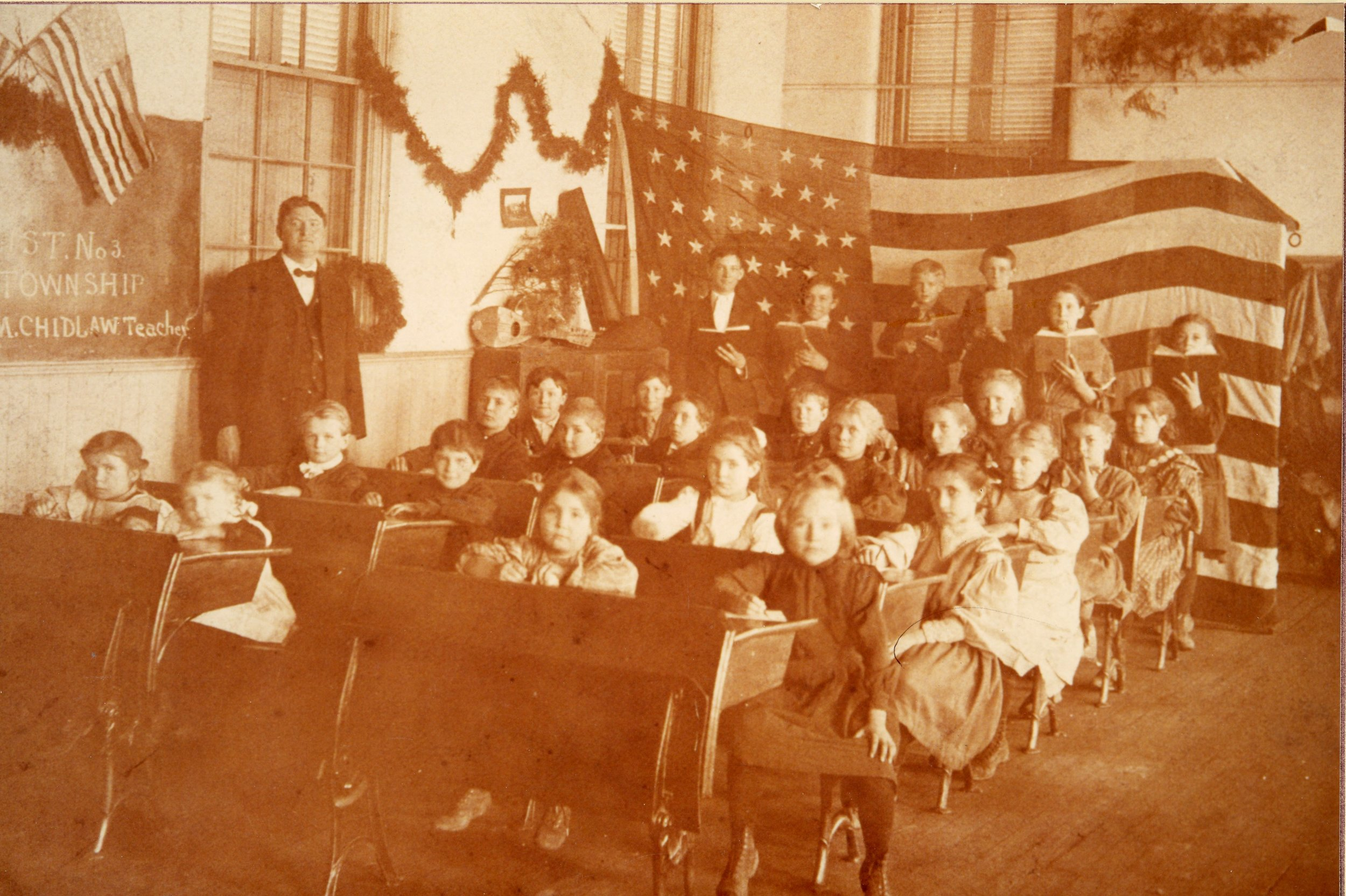 Myers Schoolhouse classroom with teacher, William Chidlaw in the early 1900s.All rights reserved: Delhi Historical Society.
