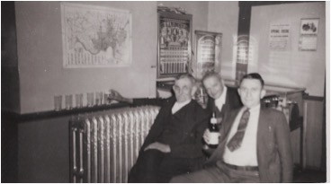 Uncle Henry Reimerink is the man closest to the radiator with the beer glasses all in a row. Henry served as a Delhi Trustee, and donated the land that some of the OLV cemetery is on, Uncle Henry lived above Klawitter's store until his death in 1954.