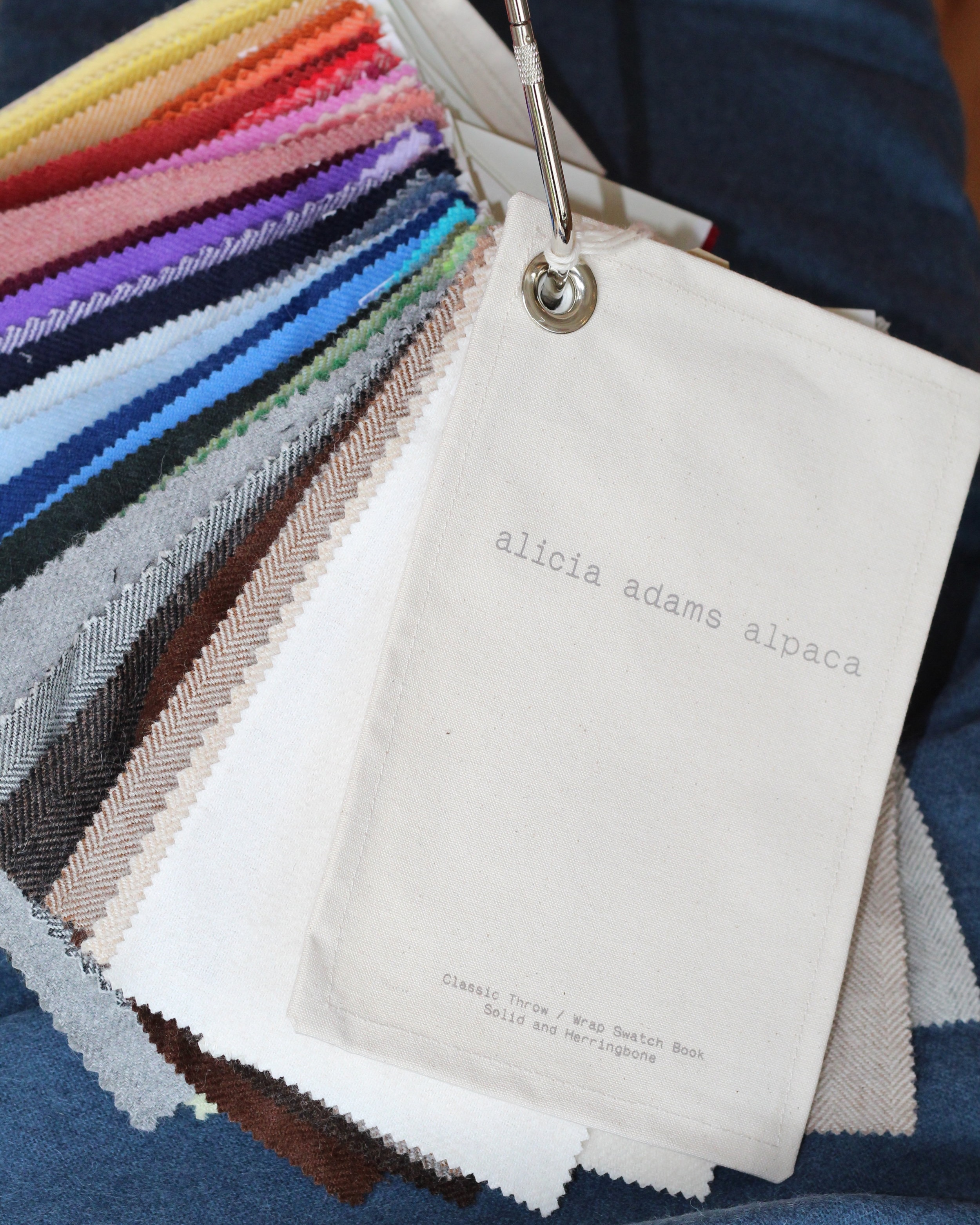 Alicia Adams Alpaca   Alicia Adams Alpaca Inc. is a family business which specializes in the design and production of textiles and clothing utilizing the natural and sustainable characteristics of one of the rarest and most luxurious materials – alpaca wool. Alpaca wool, one of the world's most luxurious fibers, is a jewel amid all the synthetic fibers and harsh materials found in our everyday lives. Softer than cashmere, and available in a wide array of colors, alpaca serves as a natural thermostat by using microscopic air pockets to trap body heat in cooler temperatures and to release heat in warmer weather.