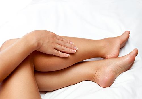 woman at bangkok day spa getting legs waxed