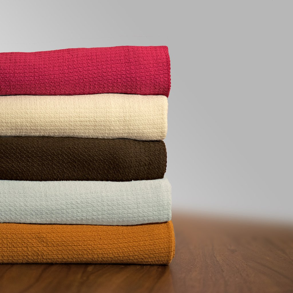 Organic cotton blankets, available in twin, full/queen, and king sizes in multiple colors