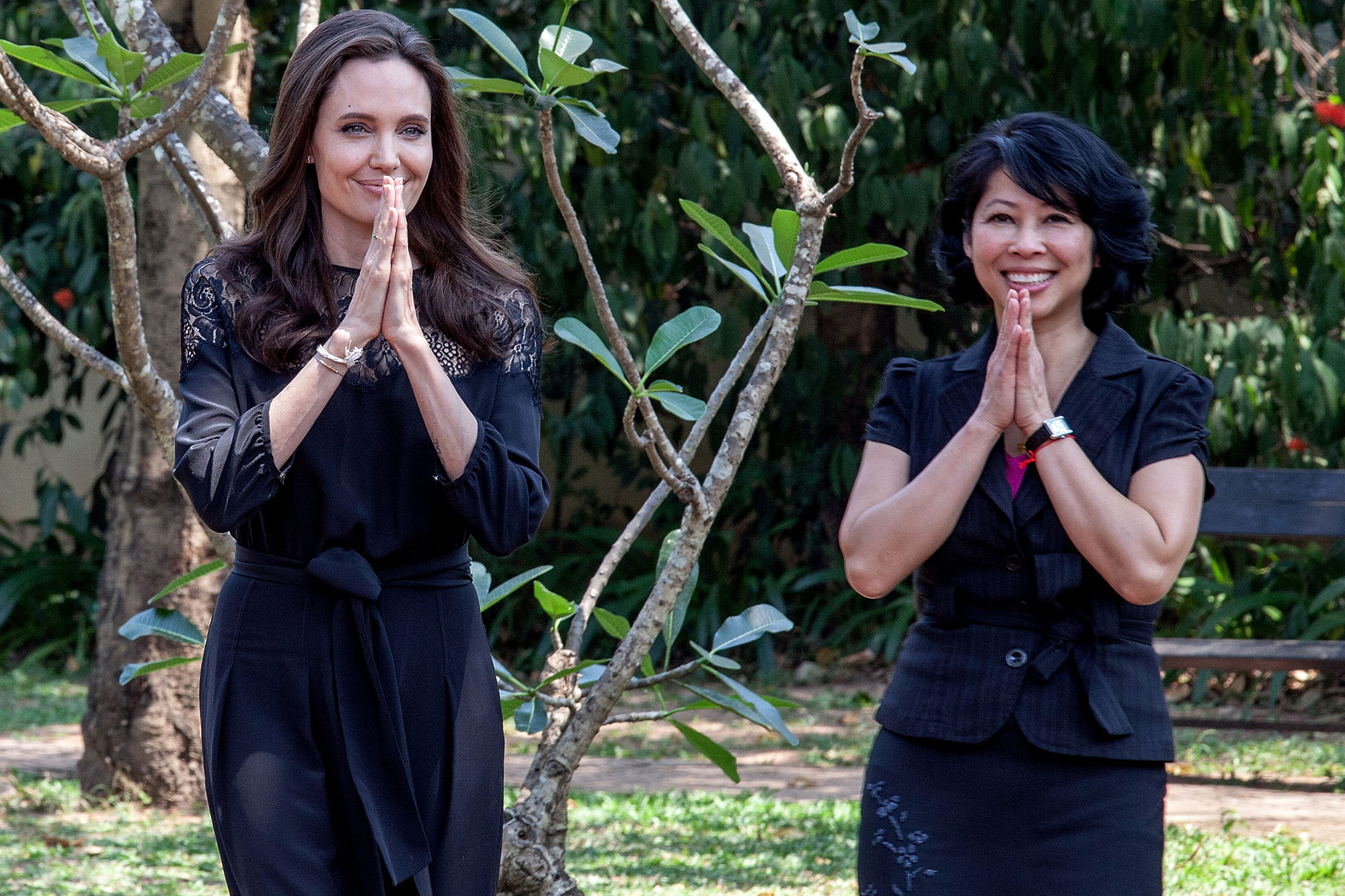 Loung Ung with Angelina Jolie arrive at a press conference for the movie  First They Killed My Father  (Samrang Pring / Reuters)