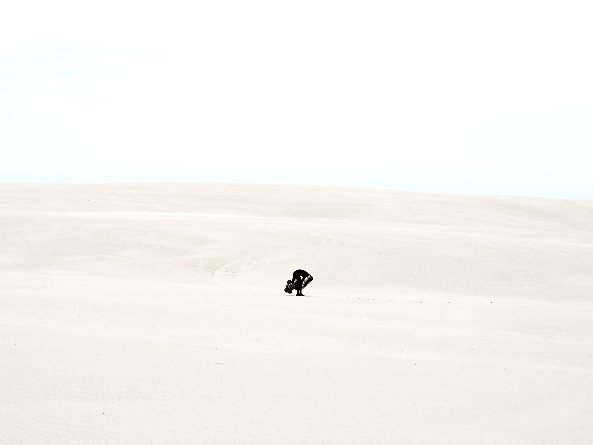 SAND DUNES AND BLACK BALLOONS