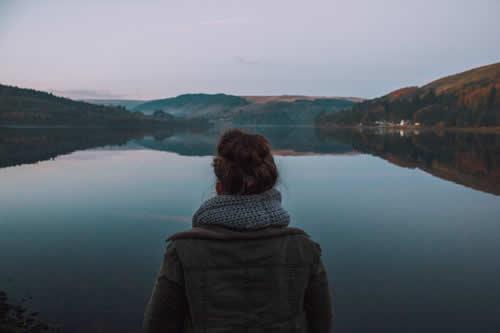 Girl staring at lake