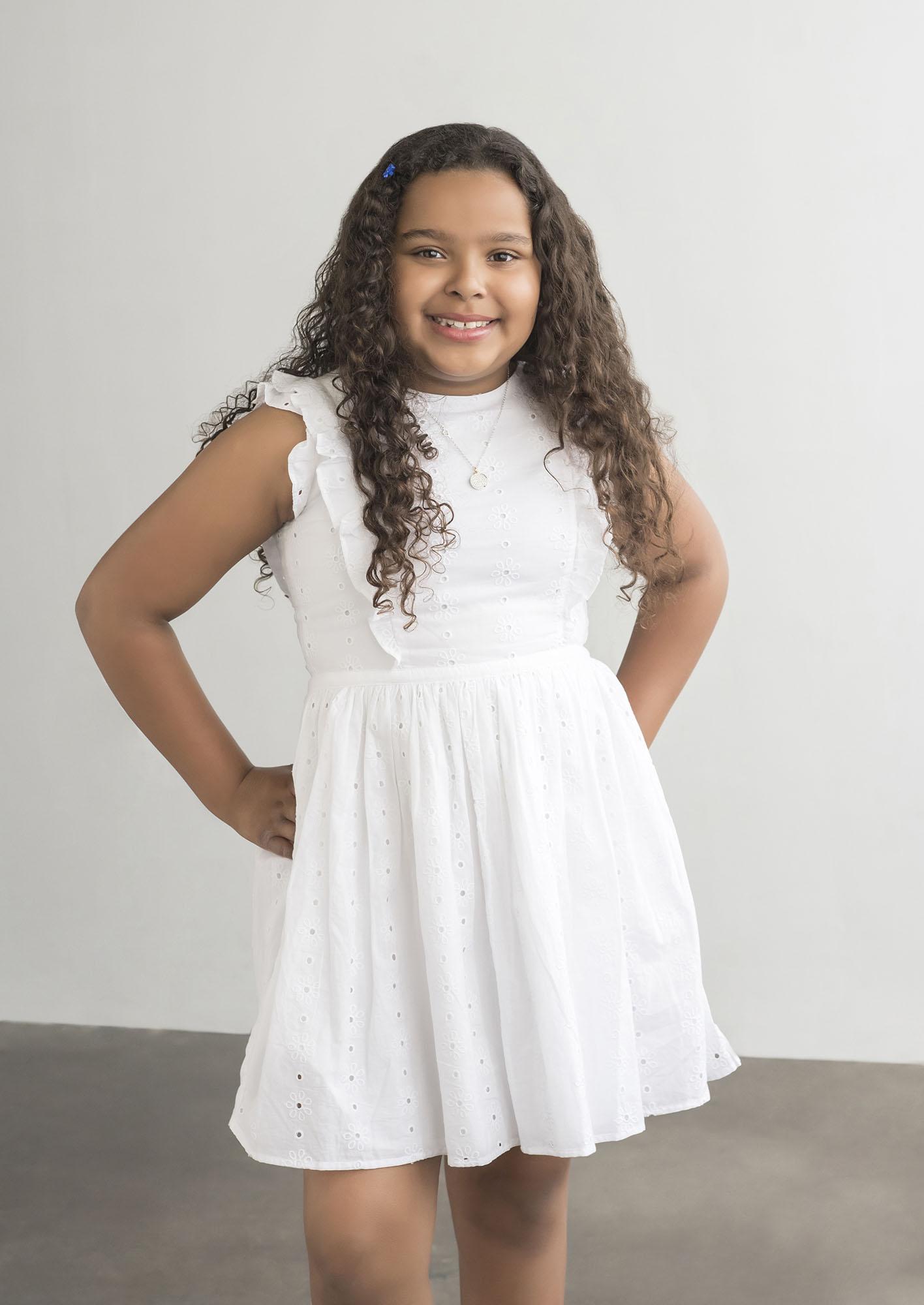 girl posing for family portraits