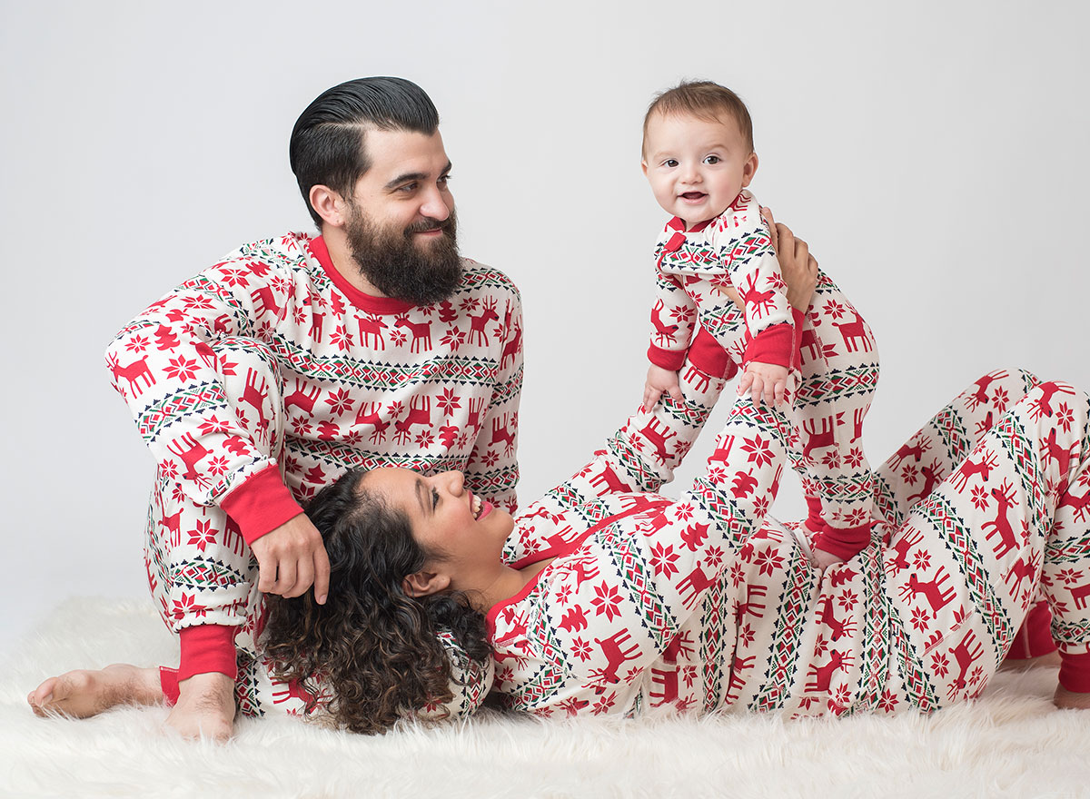 Family wearing matching holiday pajamas
