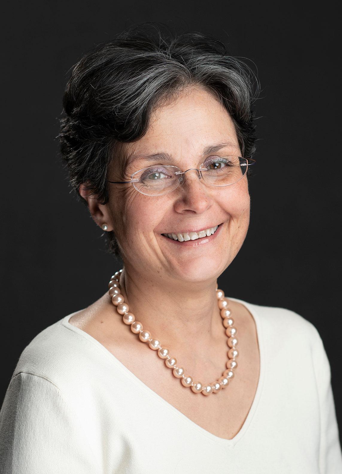 Professional headhshot of woman wearing glasses